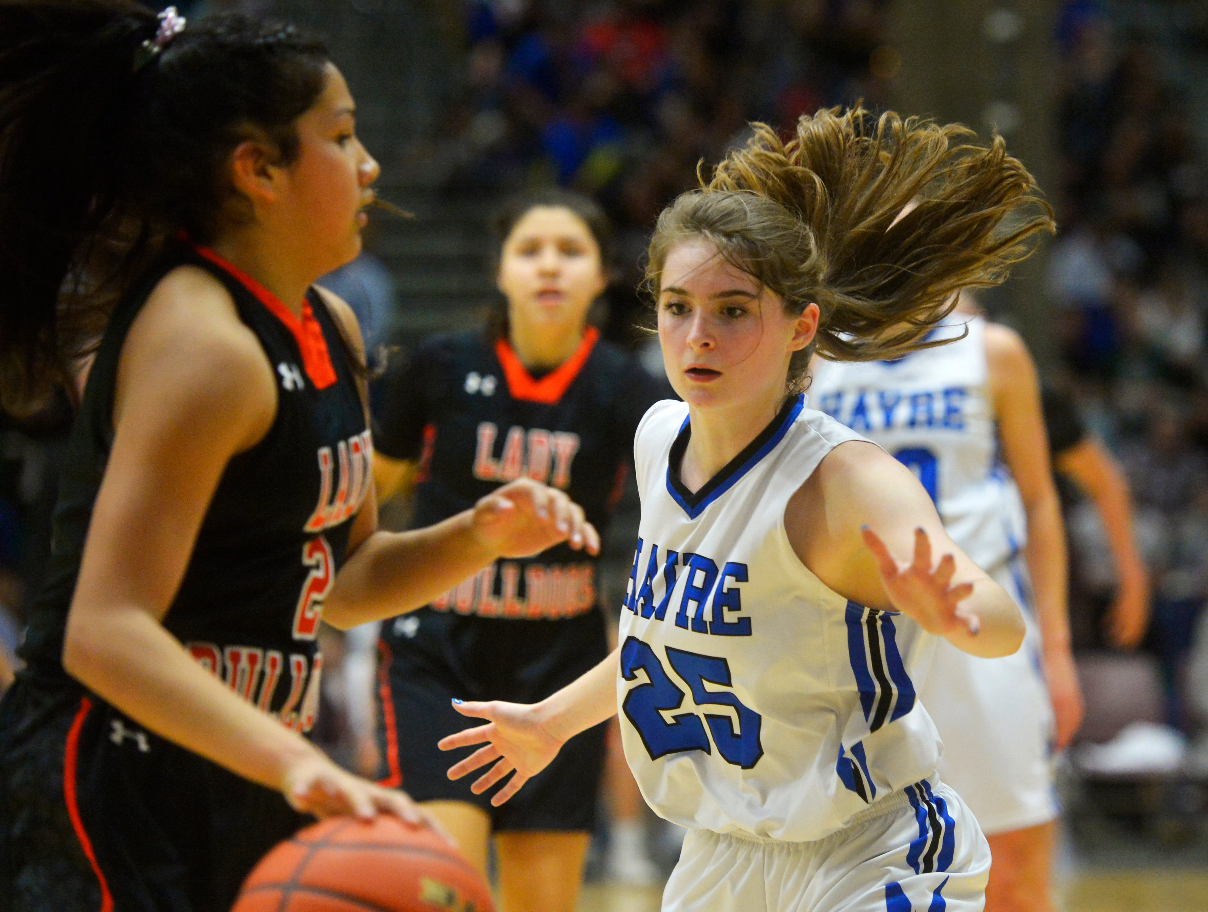 Havre's Katie Wirtzberger defends Hardin's Kamber Good Luck during the girls title game of the State Class A Basketball Tournament in the Four Seasons Arena, Saturday.