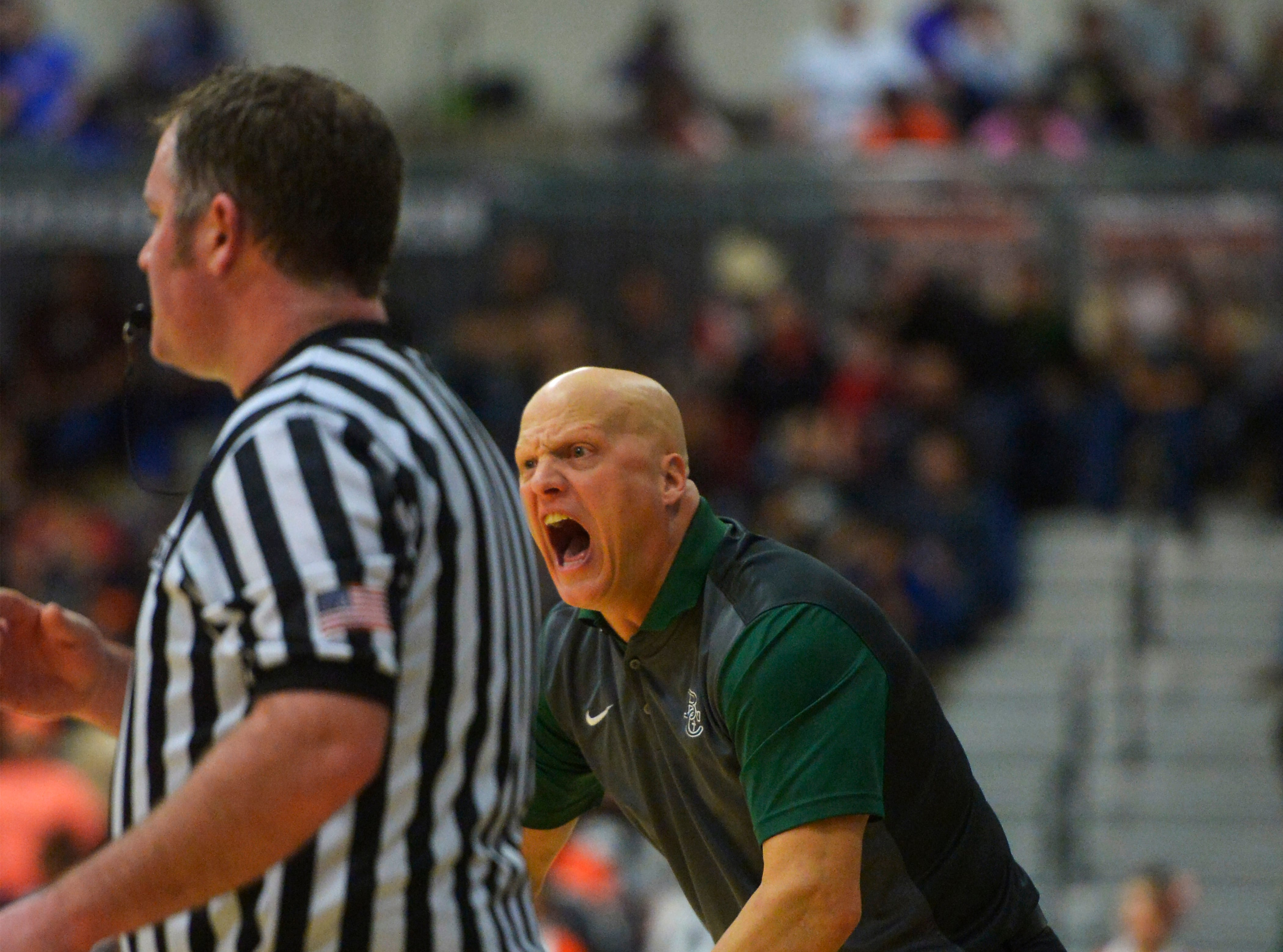 Billings Central coach Jim Stergar yells instructions to his players during the boys title game of the State Class A Basketball Tournament against Hardin in the Four Seasons Arena, Saturday.