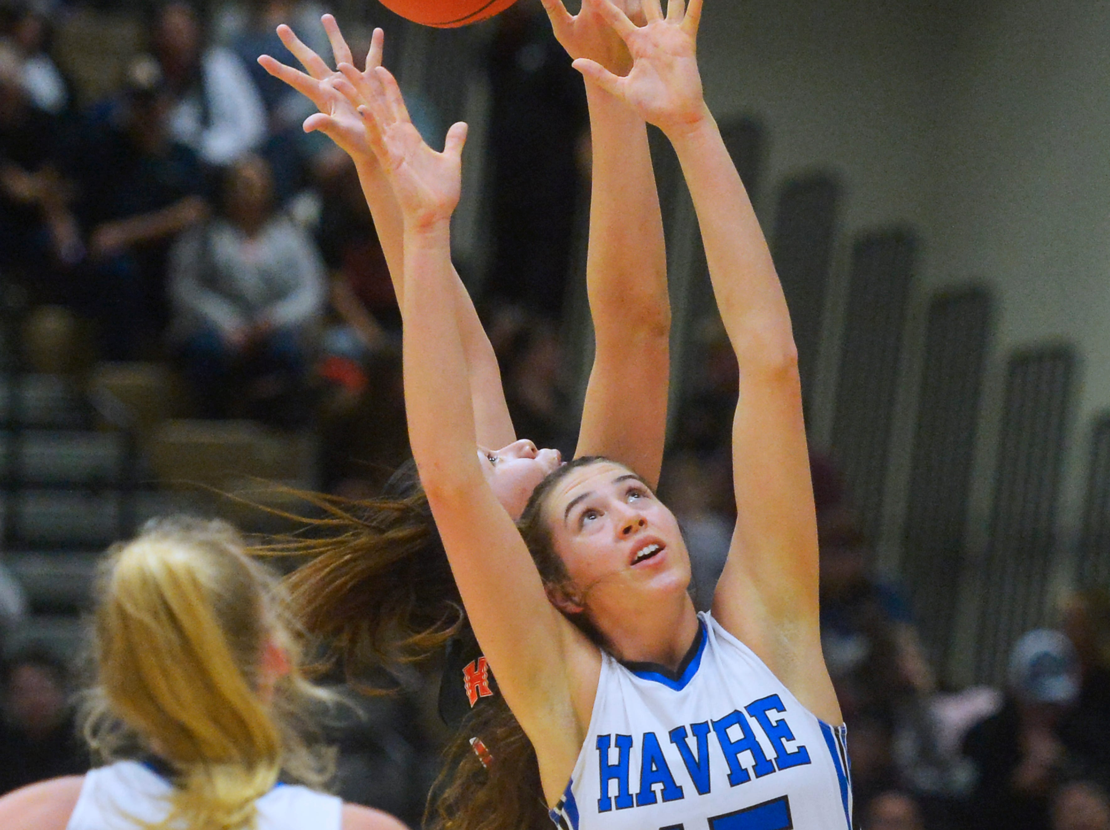 Havre's Loy Waid attempts to grab a rebound in the title game of the State Class A Basketball Tournament against Hardin in the Four Seasons Arena, Saturday.