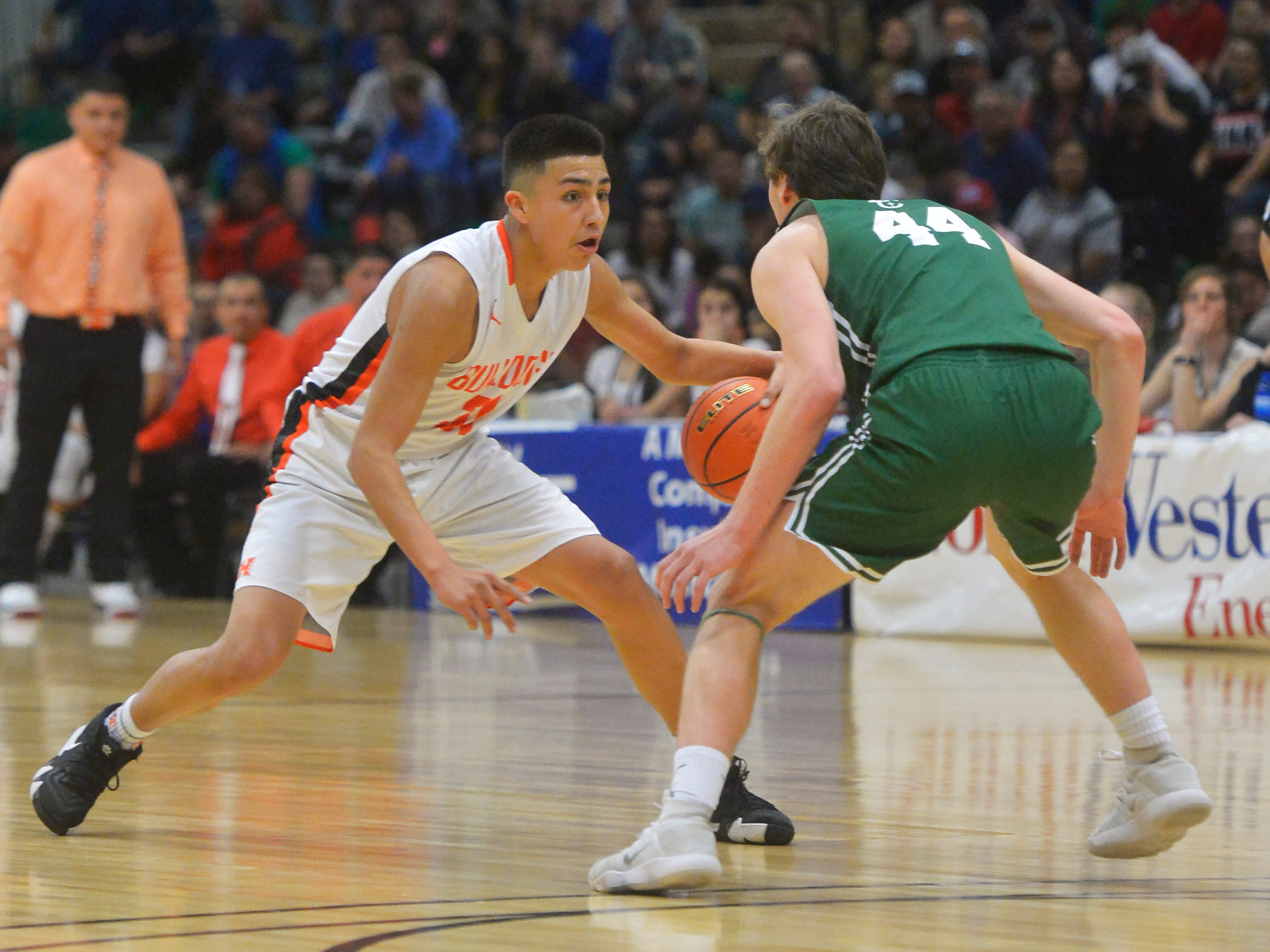 Hardin's Peyton Goodluck attempts to dribble passed Billings Central's Joe Byorth during the title game of the State Class A Basketball Tournament in the Four Seasons Arena, Saturday.