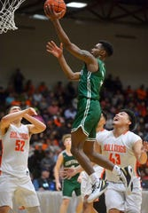 Billings Central's Chrishon Dixon goes in for a layup in the championship game of the State Class A Basketball Tournament in the Four Seasons Arena, Saturday.