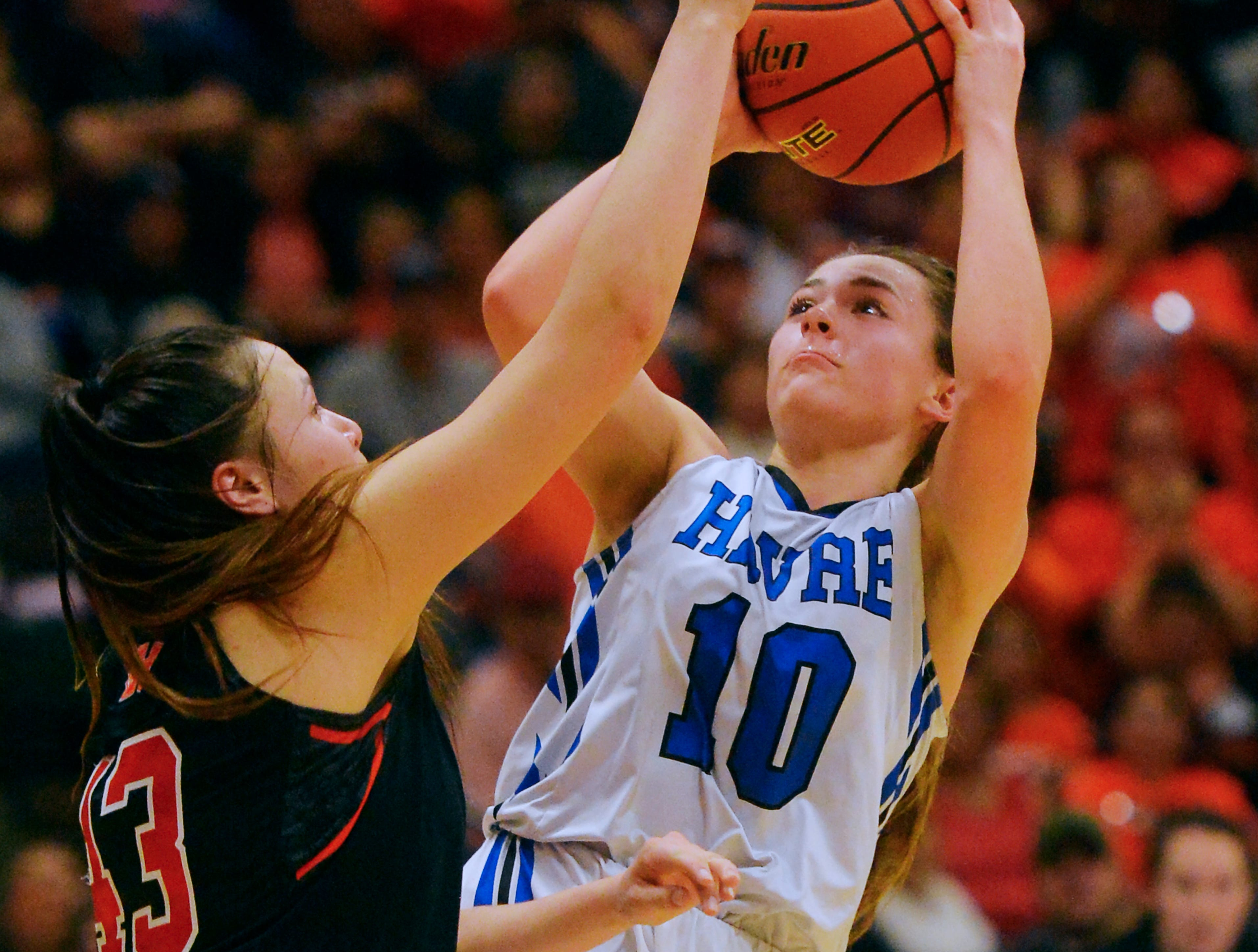 Havre's Kyndall Keller attempts to shoot over Hardin's Marie Five during the title game of the State Class A Basketball Tournament in the Four Seasons Arena, Saturday.