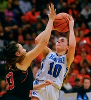 Havre's Kyndall Keller shoots over Marie Five of Hardin during the State A Girls' basketball championship game.