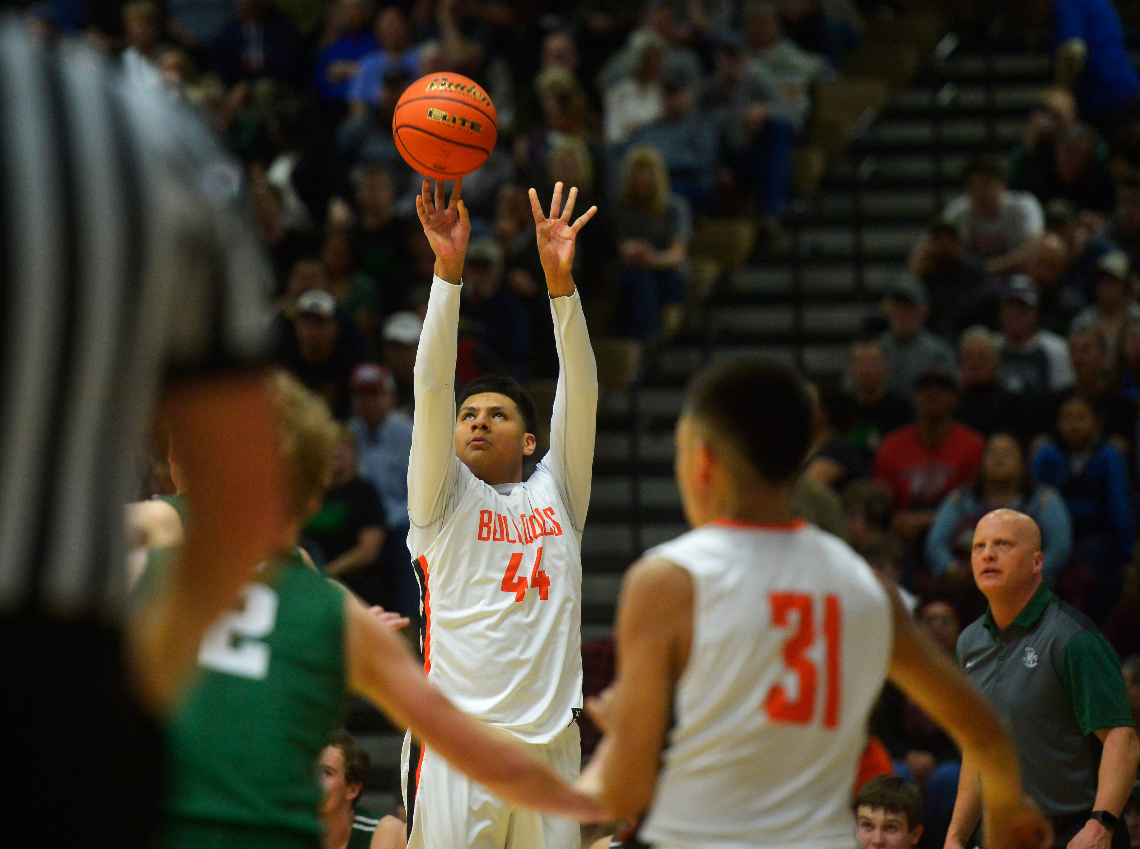 Hardin's Kidd Littlelight shoots during the title game of the State Class A Basketball Tournament against Billings Central in the Four Seasons Arena, Saturday.