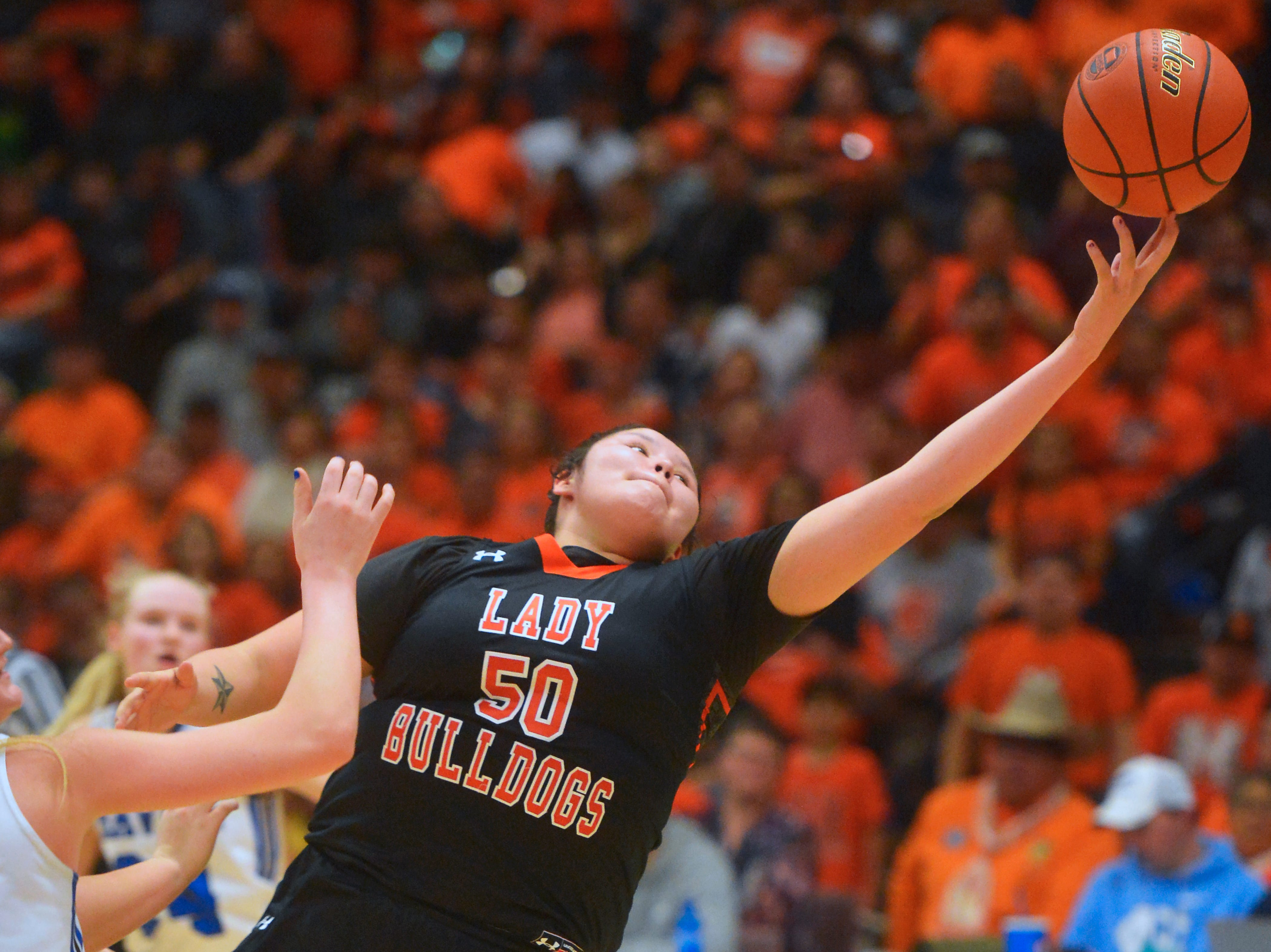 Hardin's Julianna Takes Horse attempts to pull in a rebound girls the title game of the State Class A Basketball Tournament in the Four Seasons Arena, Saturday.