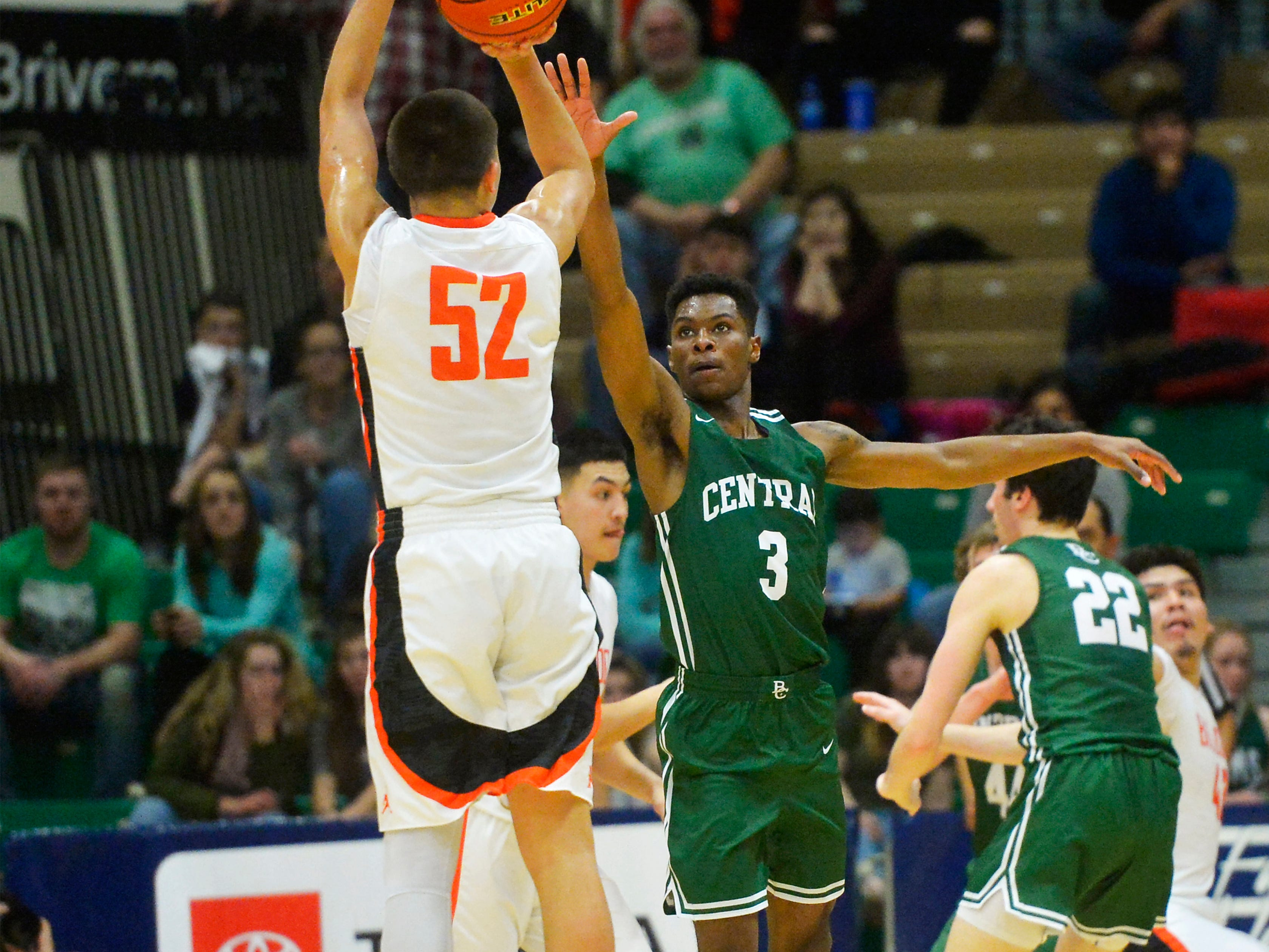 Billings Central's Chrishon Dixon defends a shot by Hardin's Famous Lefthand in the title game of the State Class A Basketball Tournament in the Four Seasons Arena, Saturday.