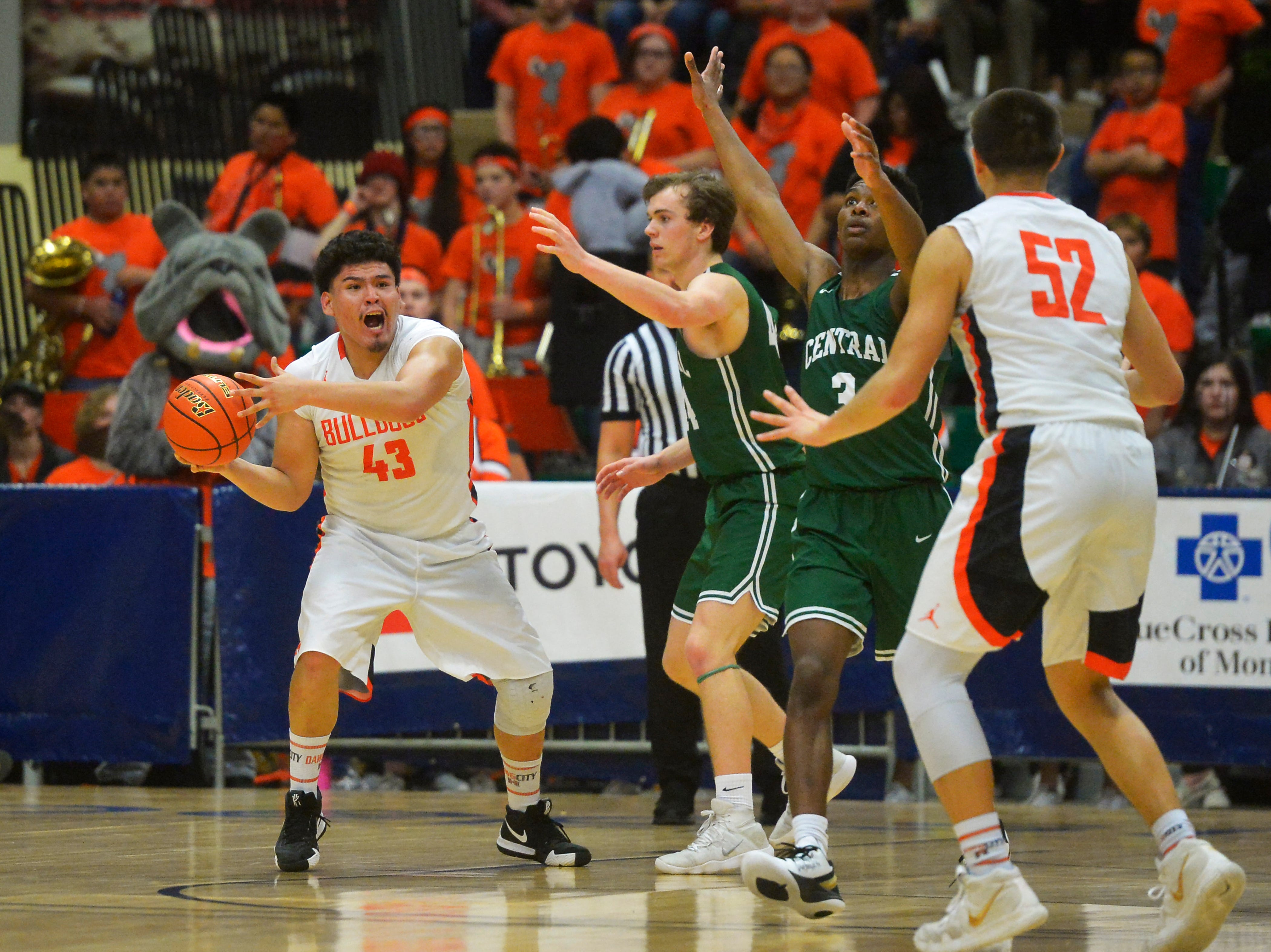 Hardin's Andrew House looks for an open teammate during the title game of the State Class A Basketball Tournament against Billings Central in the Four Seasons Arena, Saturday.