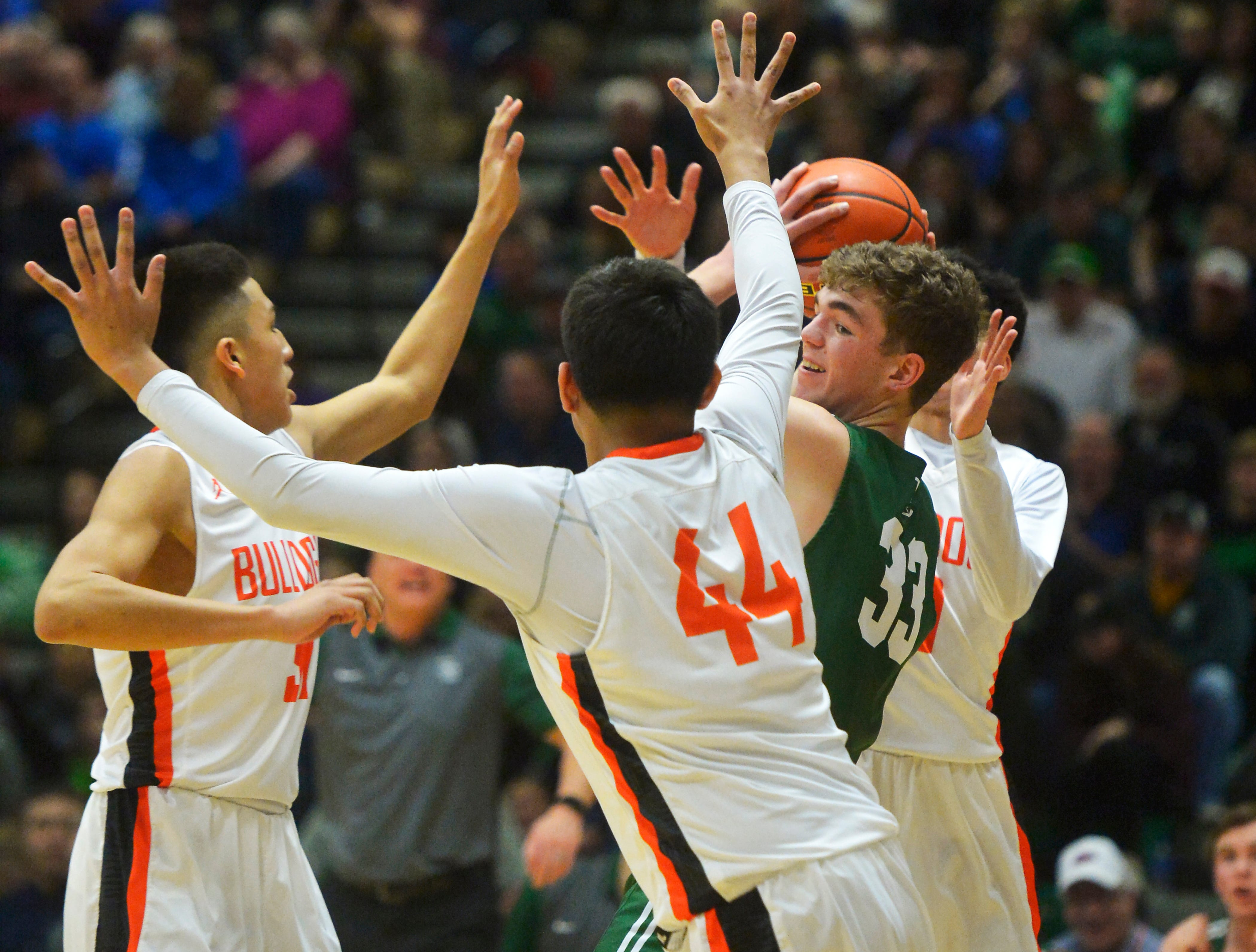 Billings Central's Sam Gray is surrounded by Hardin defenders in the title game of the State Class A Basketball Tournament in the Four Seasons Arena, Saturday.