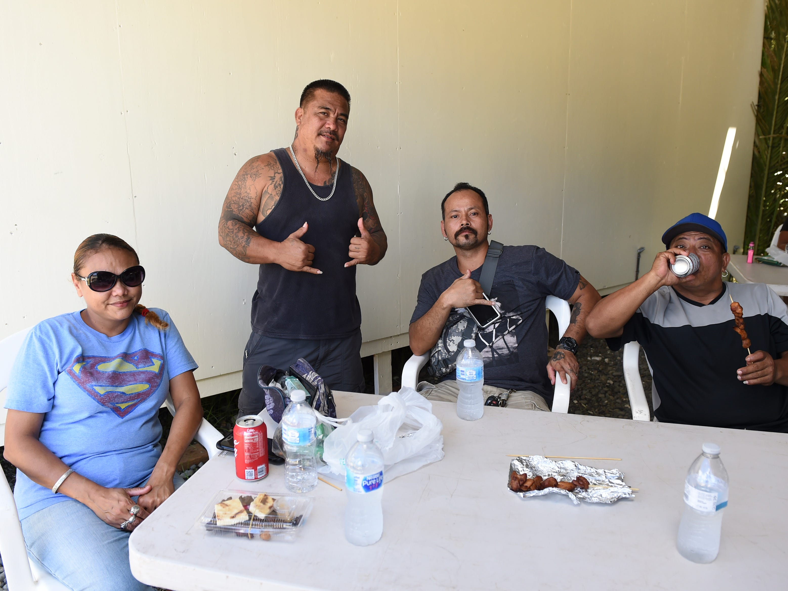 Saipan visitors catch the last day of the Guam History and Chamorro Heritage Day Festival 2019 at Umatac Bay Park, March 10, 2019. From left: Vanessa and Steven Igisaiar, Jojo Resureccion, and Bunchan Blas.