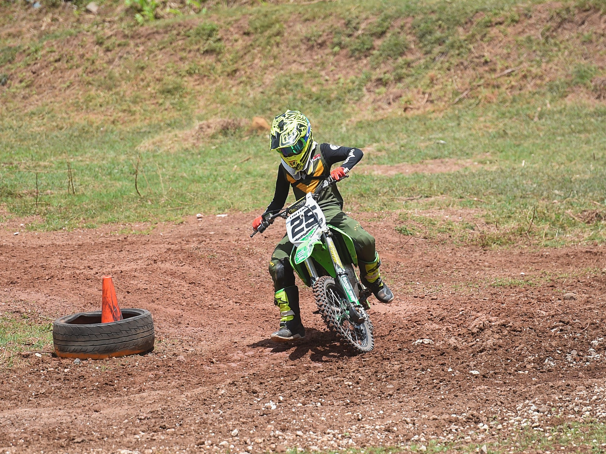 Motocross racer Lawrence Limtiaco makes a turn during a 85cc/150cc open kids minibike race in the Guam History and Chamorro Heritage Day Festival 2019 at Umatac Bay Park, March 10, 2019.
