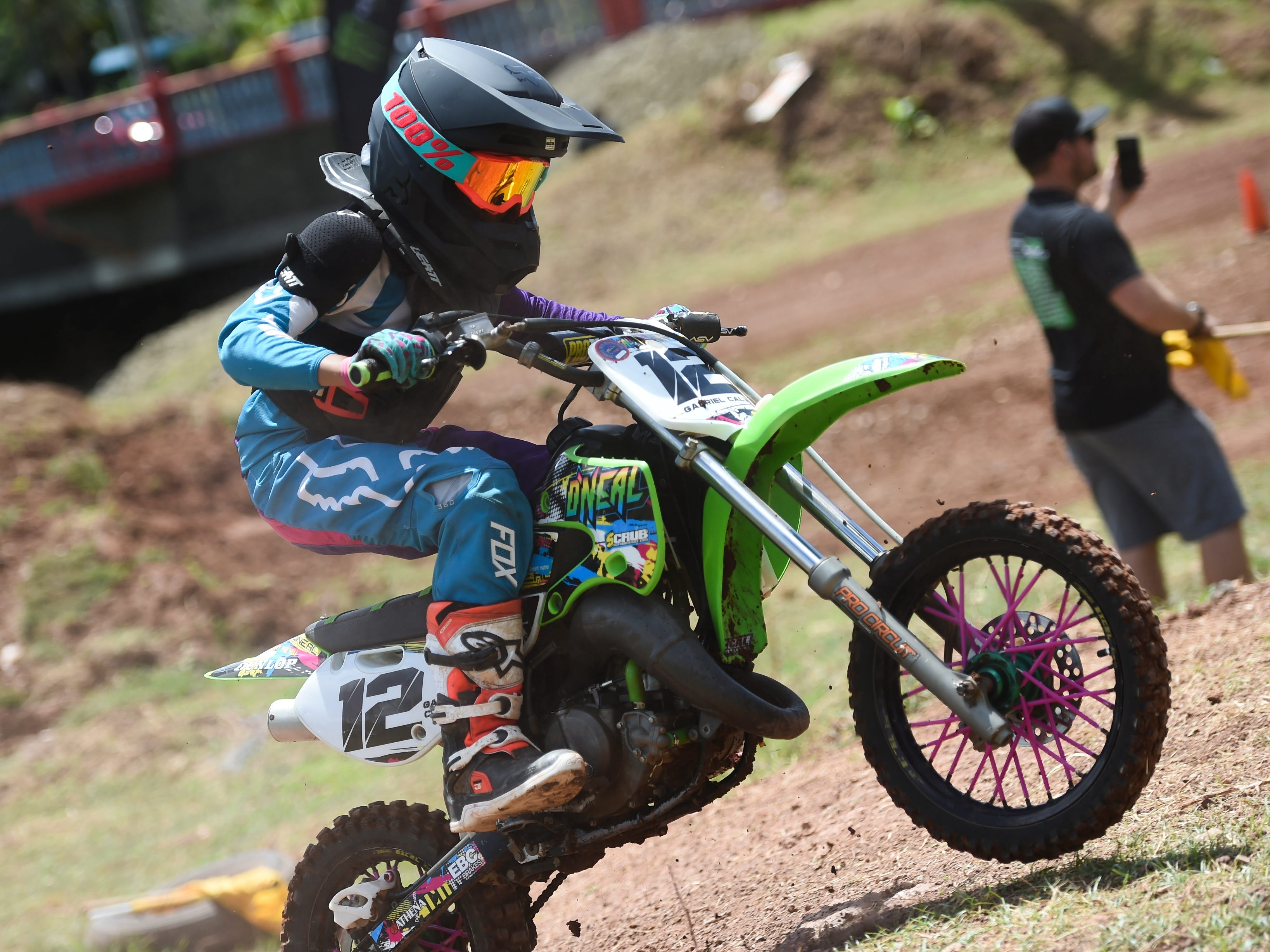 Racer Gabriel Calvo speeds through a motocross course during the Guam History and Chamorro Heritage Day Festival 2019 at Umatac Bay Park, March 10, 2019.