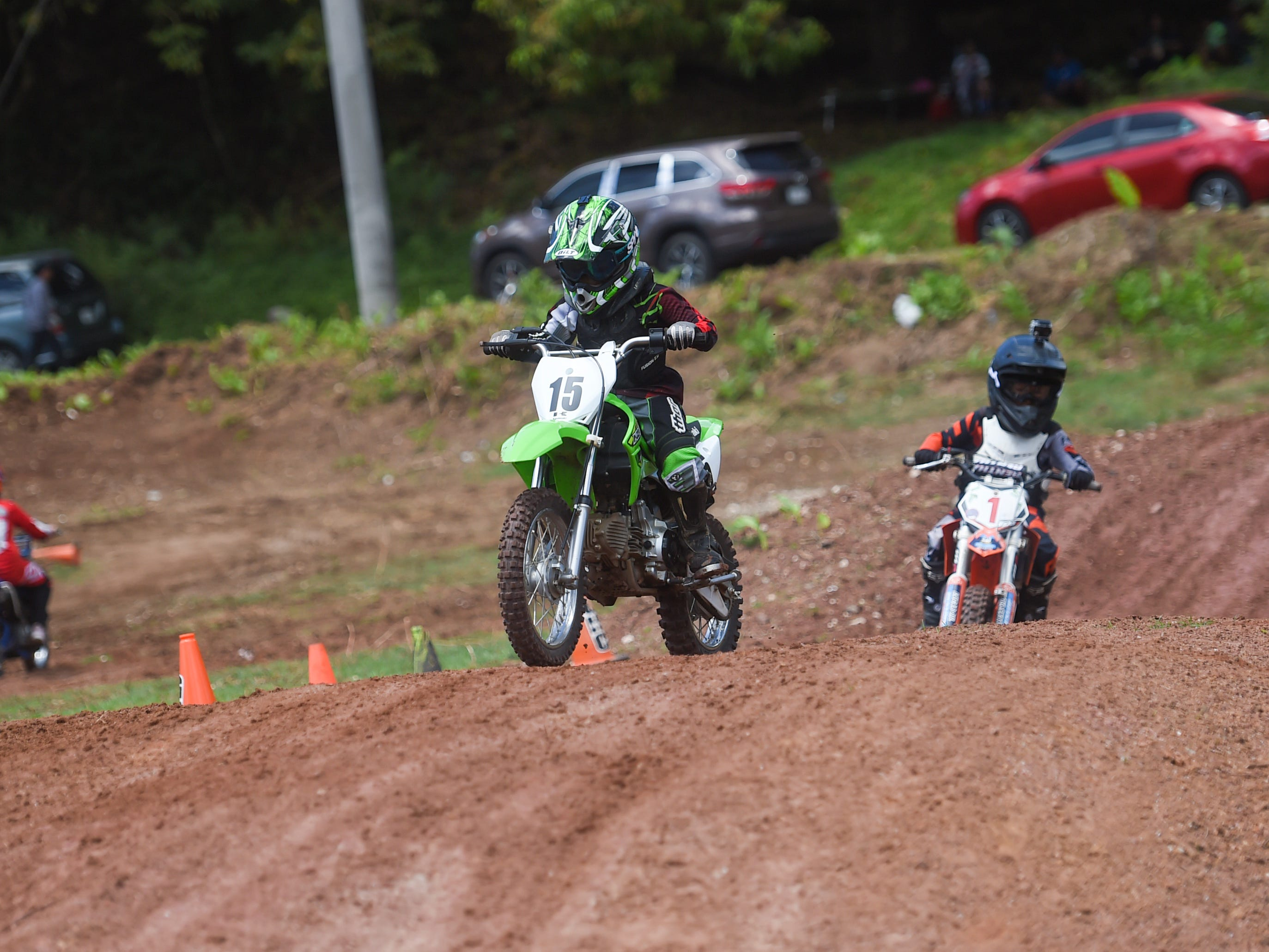 Motocross competitor Ty Overstreet (15) pulls away from John Aguon (1) during their 65cc race in the Guam History and Chamorro Heritage Day Festival 2019 at Umatac Bay Park, March 10, 2019.