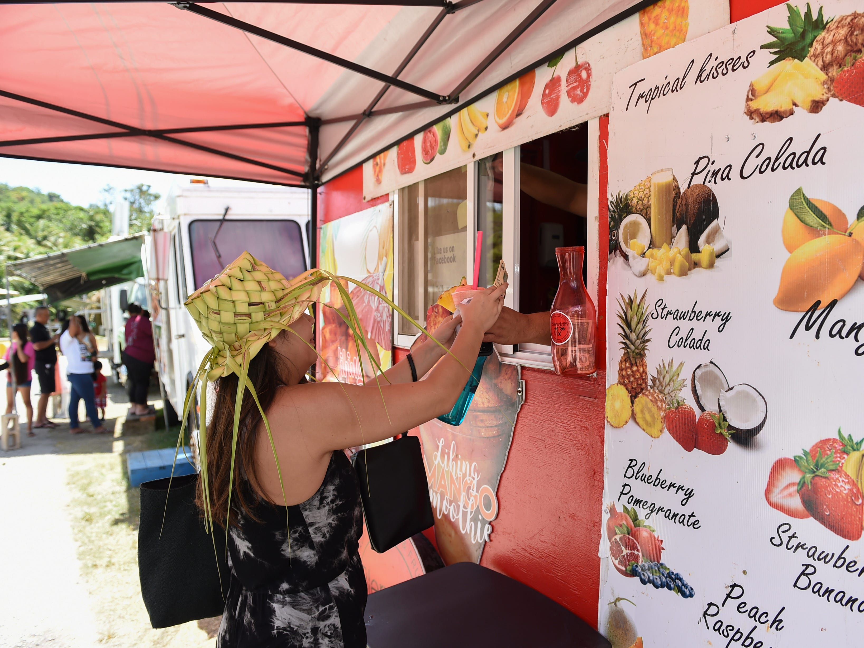 A customer receives her drink at the Blenddit Mix stand during the Guam History and Chamorro Heritage Day Festival 2019 at Umatac Bay Park, March 10, 2019.