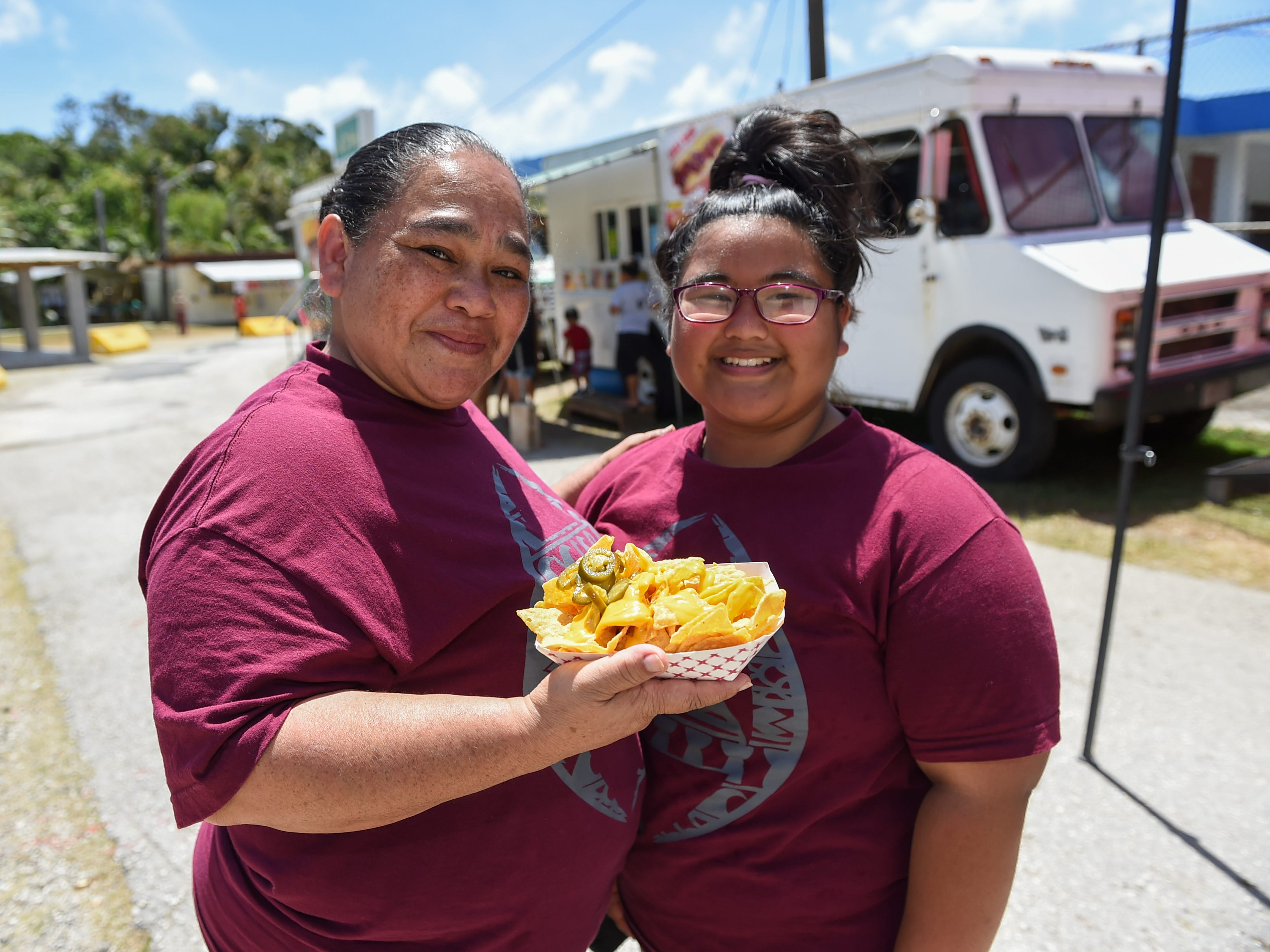 Agat residents Viba Navarro and her daughter Maria Navarro, 12, during the Guam History and Chamorro Heritage Day Festival 2019 at Umatac Bay Park, March 10, 2019.