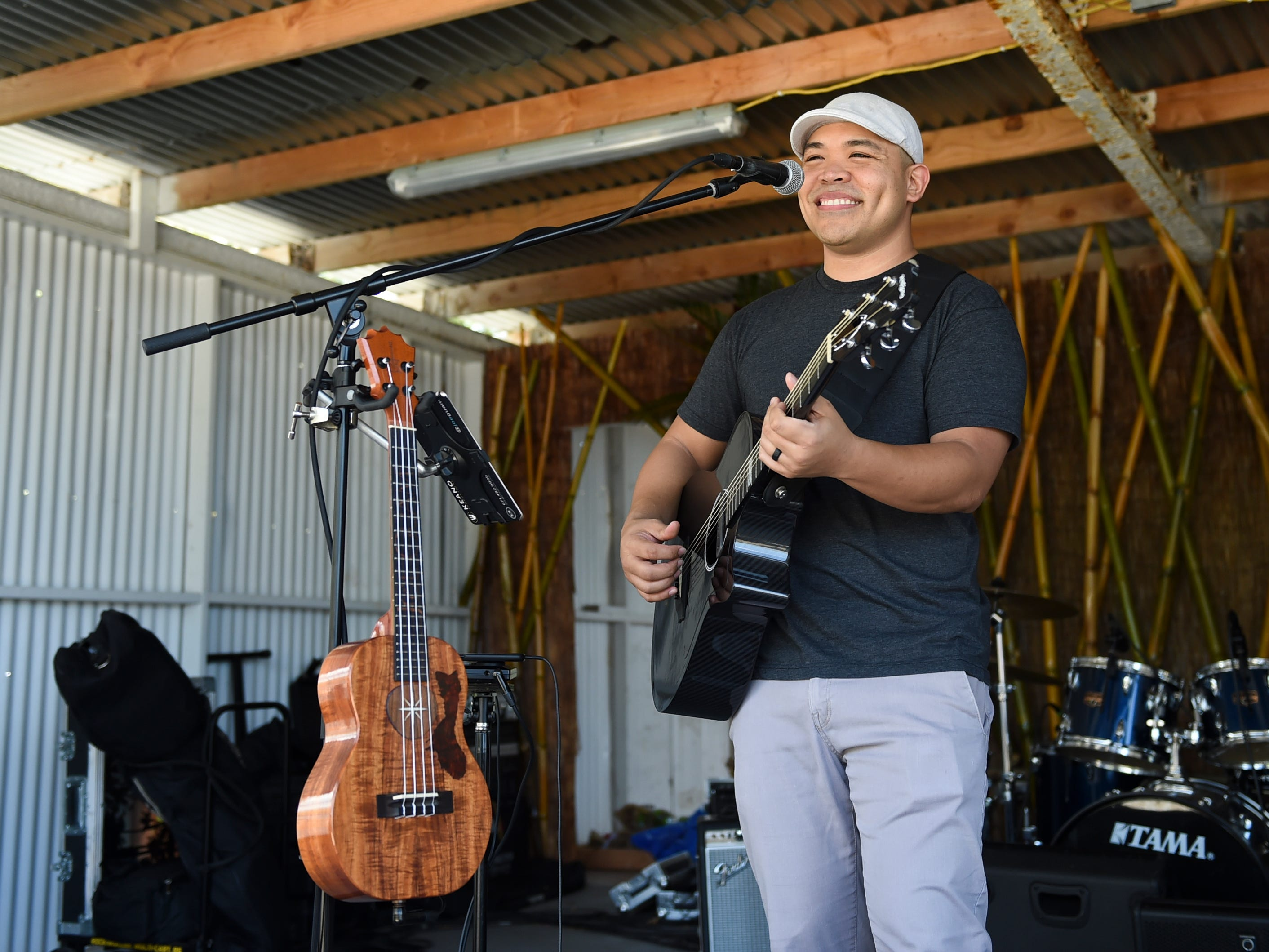 Local artist Joe Guam performs during the Guam History and Chamorro Heritage Day Festival 2019 at Umatac Bay Park, March 10, 2019.