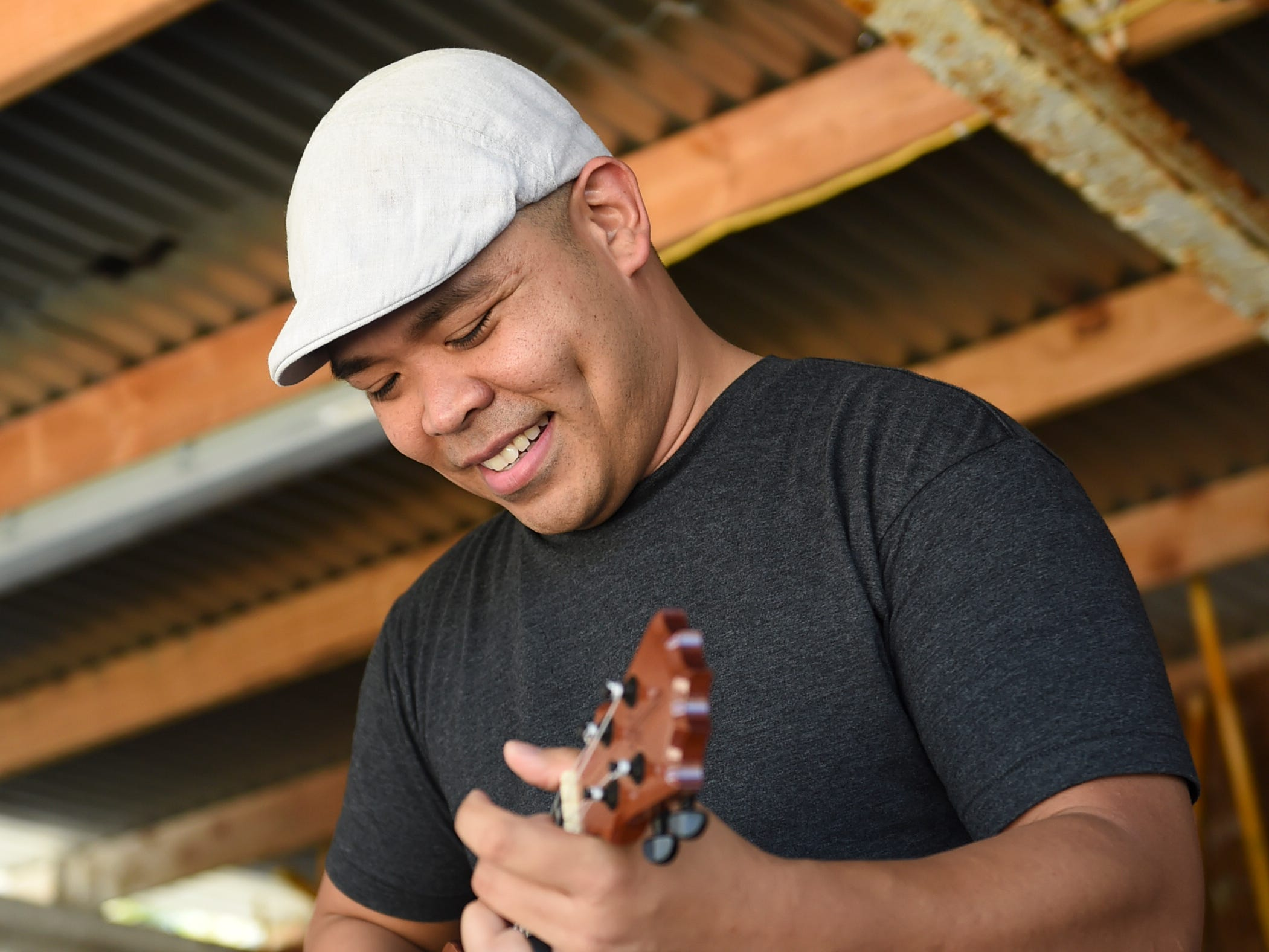 Local artist Joe Guam plays a song on the ukelele during the Guam History and Chamorro Heritage Day Festival 2019 at Umatac Bay Park, March 10, 2019.