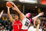 Megan Gustafson of Iowa locks the shot of Rutgers' Zipporah Broughton in the Hawkeyes 72-67 win in Saturday's conference tournament semifinals.