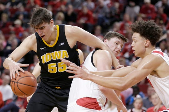 Iowa's Luka Garza tries to control the ball against the defense of Nebraska's Tanner Borchardt (center) and Isaiah Roby during the first half Sunday at Pinnacle Bank Arena..