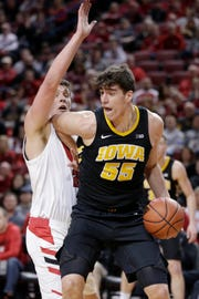 Iowa center Luka Garza (55), being  defended by Nebraska's Tanner Borchardt in the first half, scored 25 points to lead the Hawkeyes on Sunday.