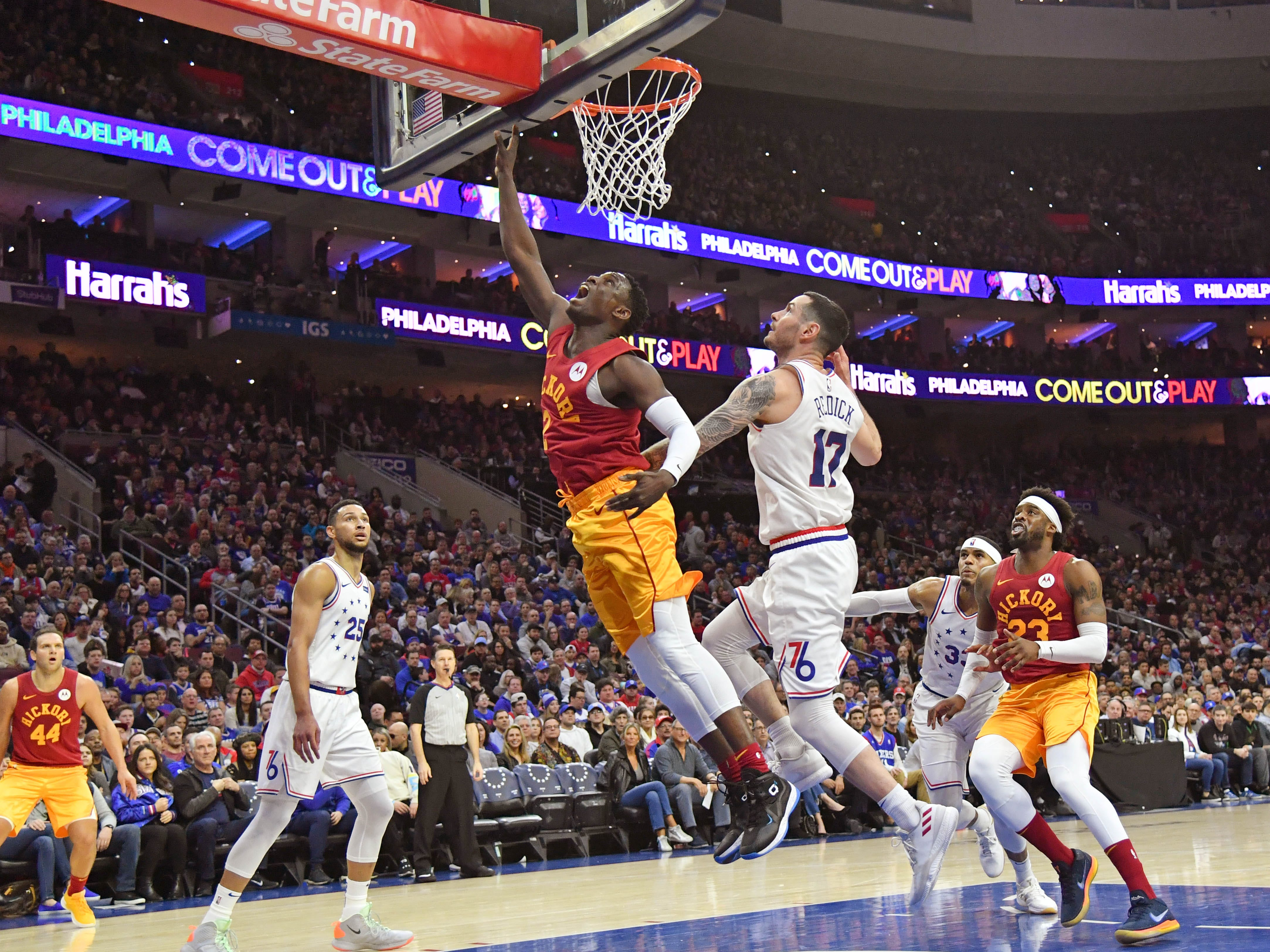 Mar 10, 2019; Philadelphia, PA, USA; Indiana Pacers guard Darren Collison (2) makes a lay up past Philadelphia 76ers guard JJ Redick (17) during the first quarter at Wells Fargo Center.
