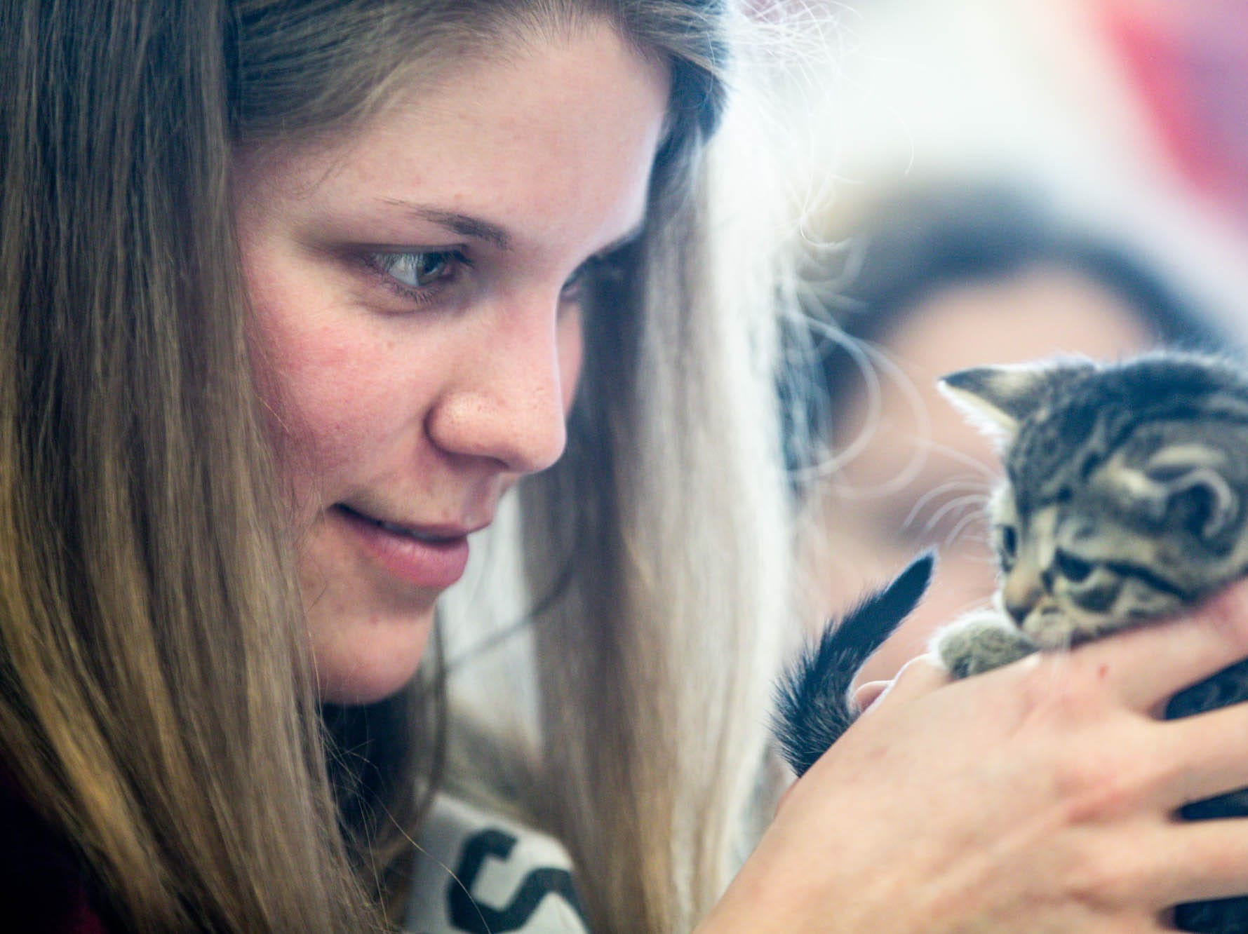 Sarah Martens holds a little kitten up for adoption during the Indy Humane Puppy and Kitten Baby Shower on Sunday, March 10, 2019. The event educates families on Indy Humane's foster care program, as Fosters are needed in the spring during puppy and kitten season.