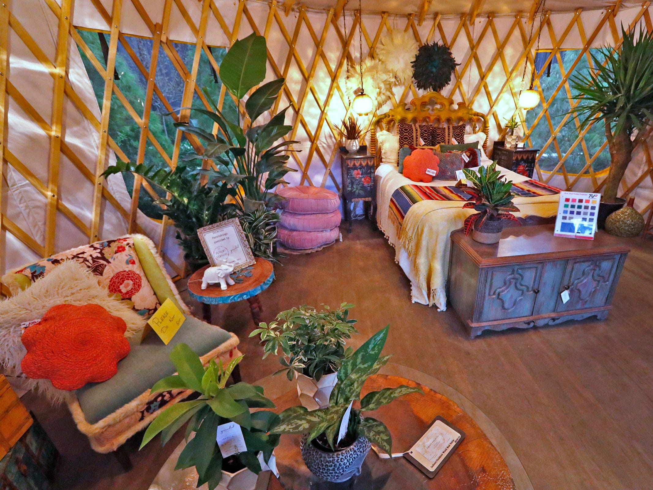 A bed is displayed in a Yurts of America yurt at the Indiana Flower + Patio Show, at the Indiana State Fairgrounds, Sunday, March 10, 2019.  New Leaf Landscape Design Studio worked with others to furnish and decorate the temporary living space.