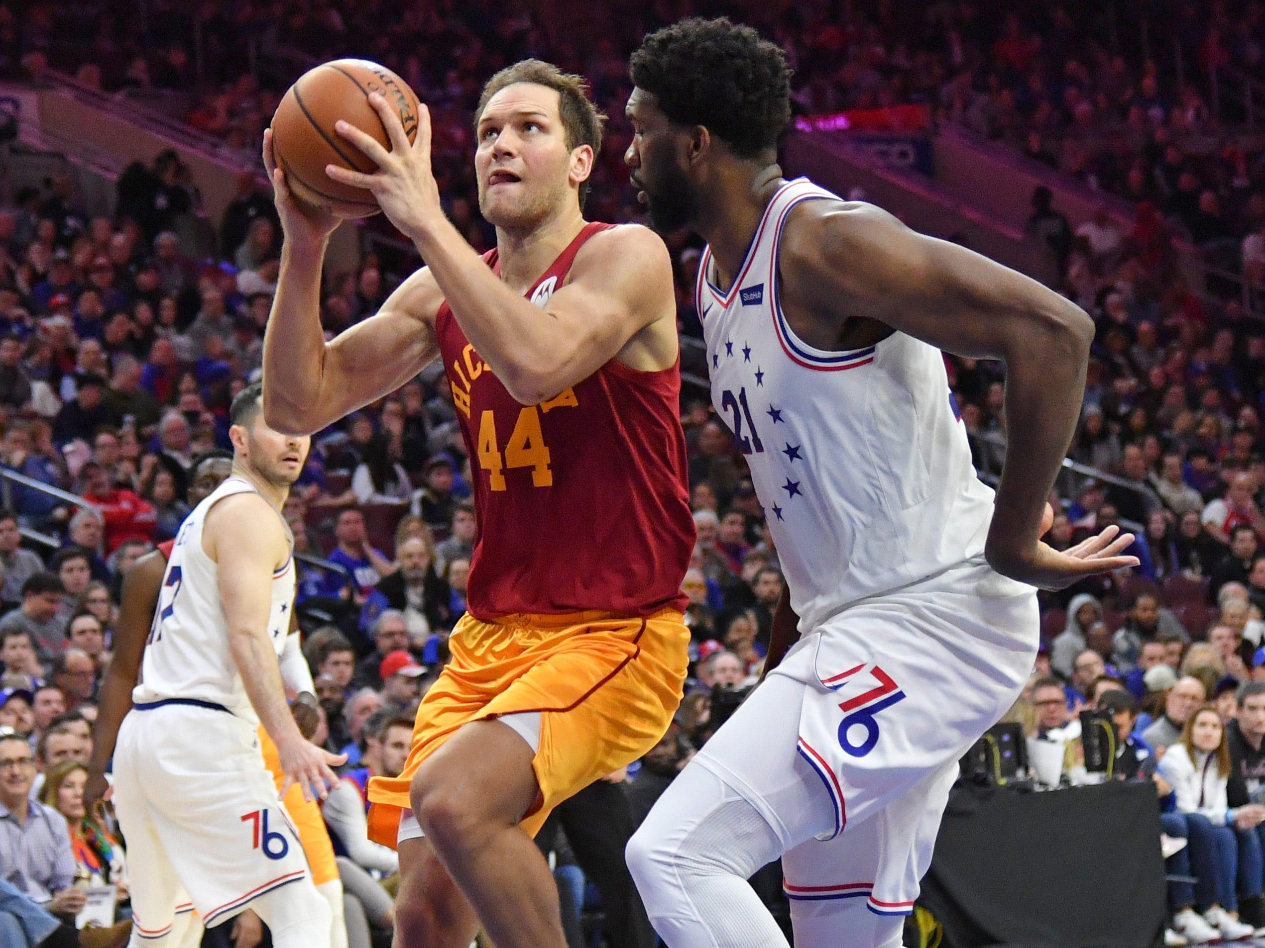 Mar 10, 2019; Philadelphia, PA, USA; Indiana Pacers forward Bojan Bogdanovic (44) drives to the basket against Philadelphia 76ers center Joel Embiid (21) during the second quarter at Wells Fargo Center.