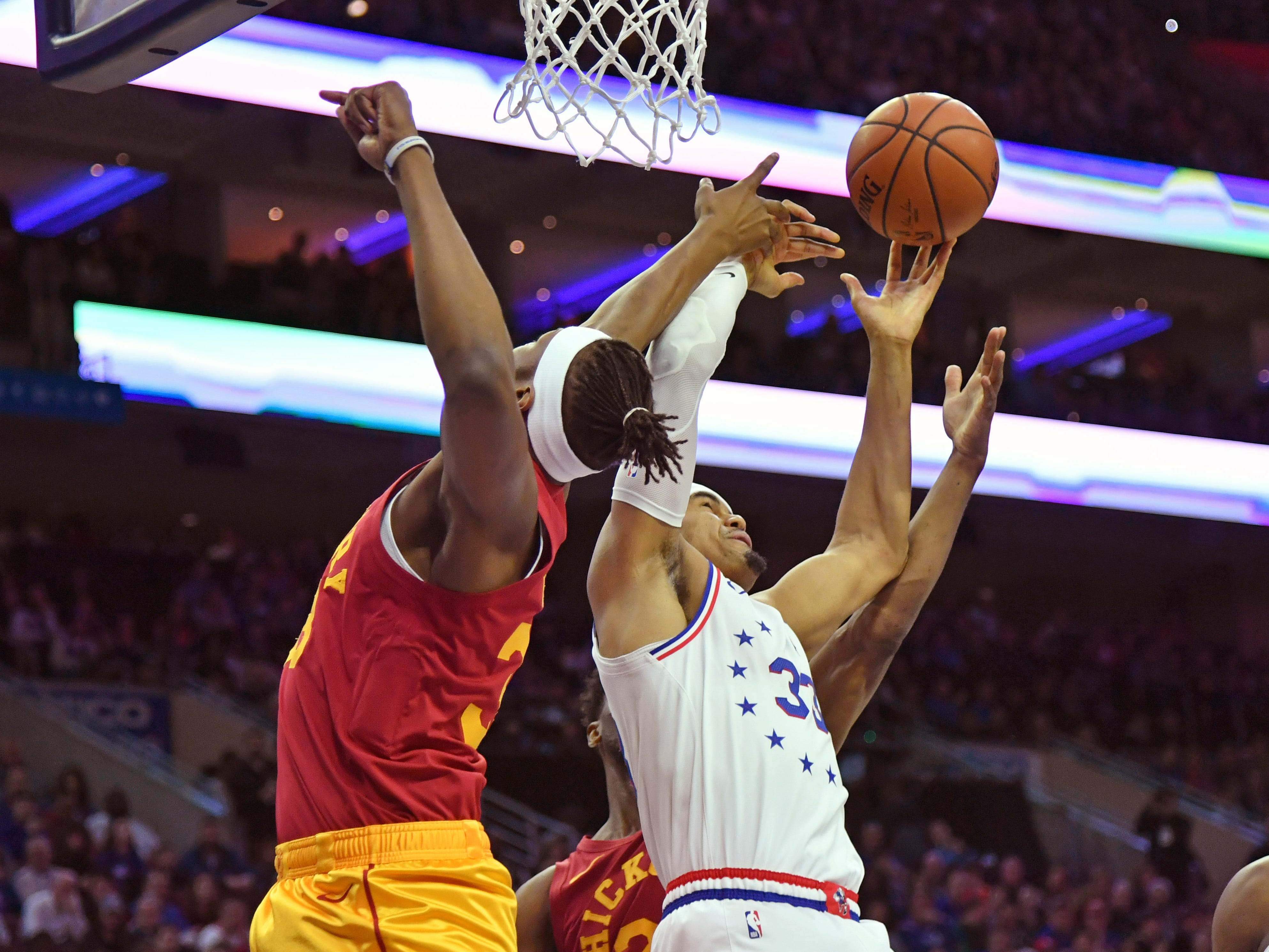 Mar 10, 2019; Philadelphia, PA, USA; Indiana Pacers center Myles Turner (33) and Philadelphia 76ers forward Tobias Harris (33) battle for the ball during the first quarter at Wells Fargo Center.