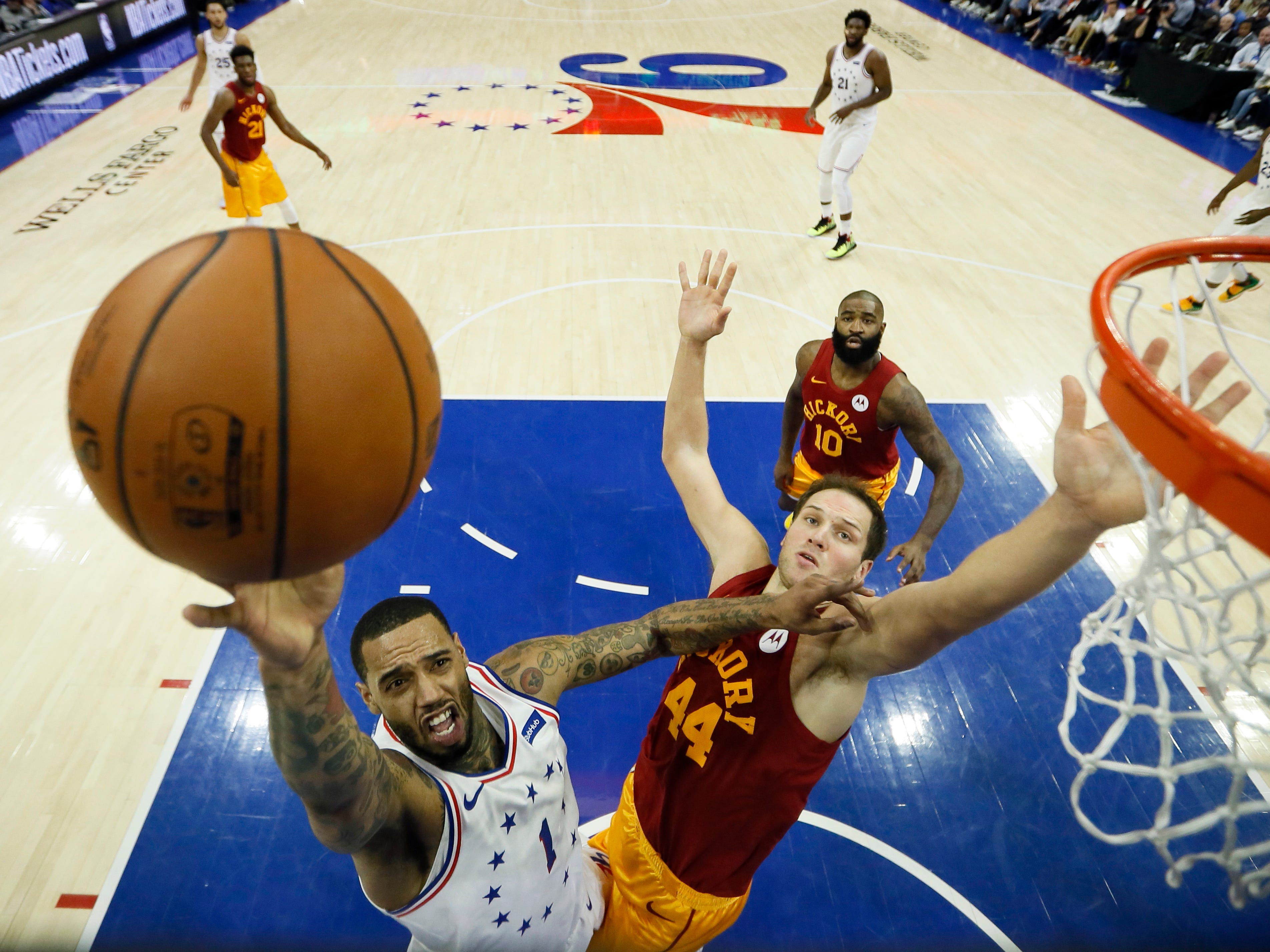 Philadelphia 76ers' Mike Scott (1) goes up for a shot past Indiana Pacers' Bojan Bogdanovic (44) during the first half of an NBA basketball game, Sunday, March 10, 2019, in Philadelphia.