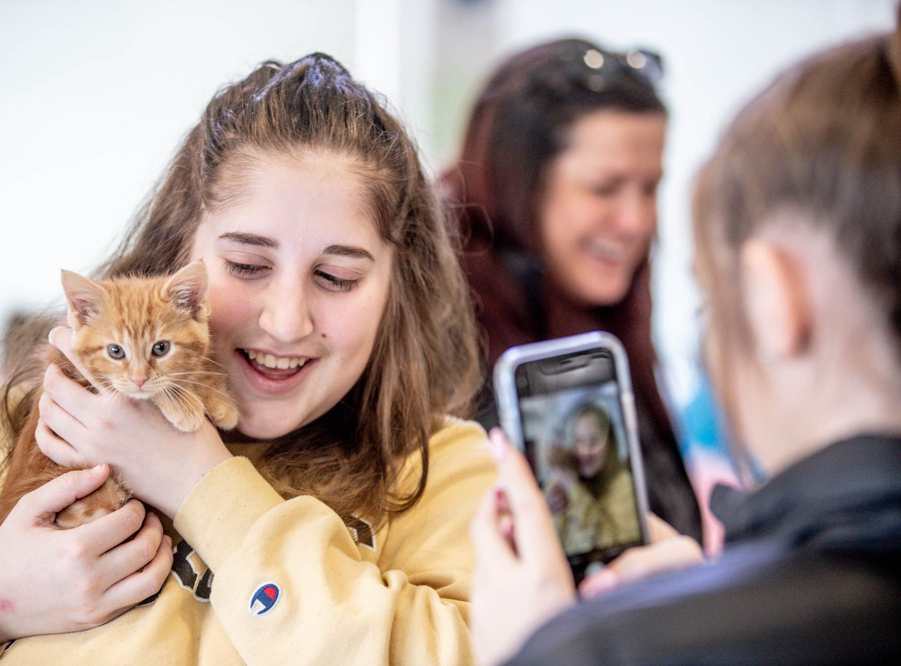Emily Parsons is photographed by her sister, Elizabeth Parsons, during the Puppy and Kitten Baby Shower, held at Indy Humane on Sunday, March 10, 2019. The event educates families on Indy Humane's foster care program, as Fosters are needed in the spring during puppy and kitten season.