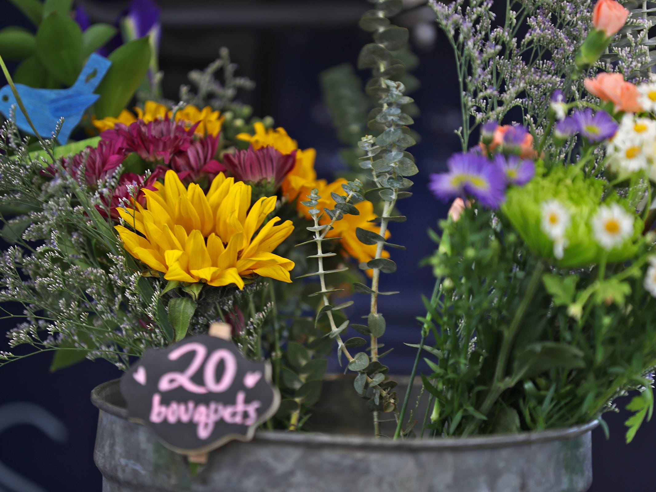 Flowers and greenery are for sale at the Stemsflowertruck.com display at the Indiana Flower + Patio Show, at the Indiana State Fairgrounds, Sunday, March 10, 2019.