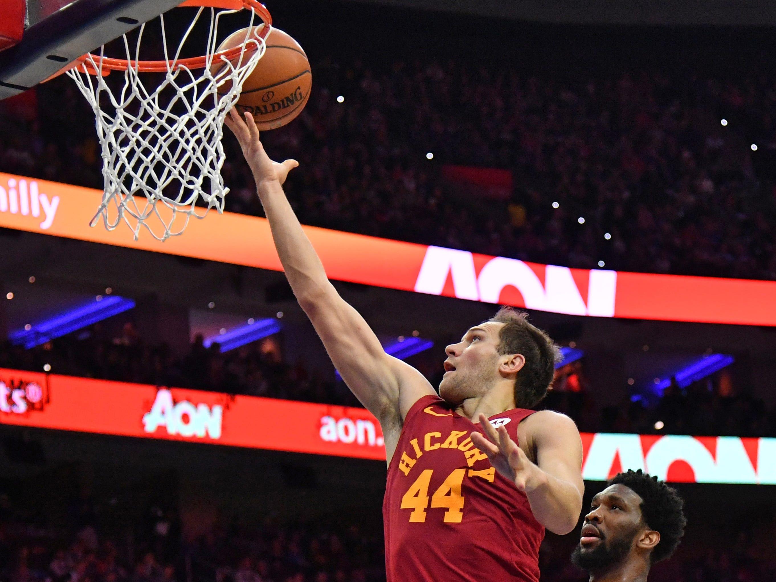 Mar 10, 2019; Philadelphia, PA, USA; Indiana Pacers forward Bojan Bogdanovic (44) makes a lay up agaisnt Philadelphia 76ers center Joel Embiid (21) during the second quarter at Wells Fargo Center.