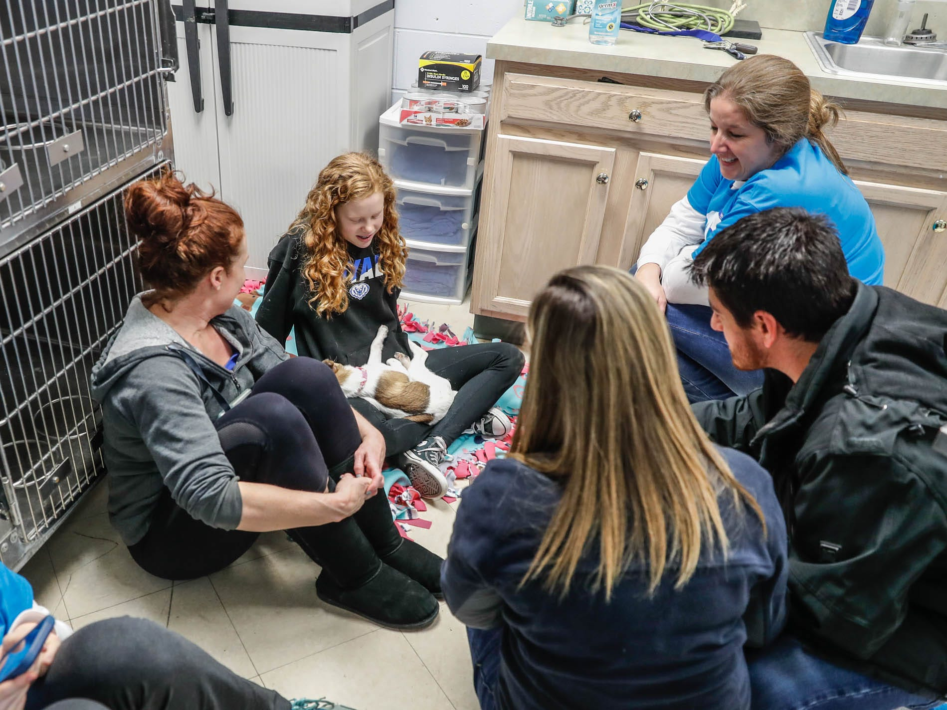 Guests and volunteers cuddle a puppy during the Puppy and Kitten Baby Shower, held at Indy Humane on Sunday, March 10, 2019. The event educates families on Indy Humane's foster care program, as Fosters are needed in the spring during puppy and kitten season.