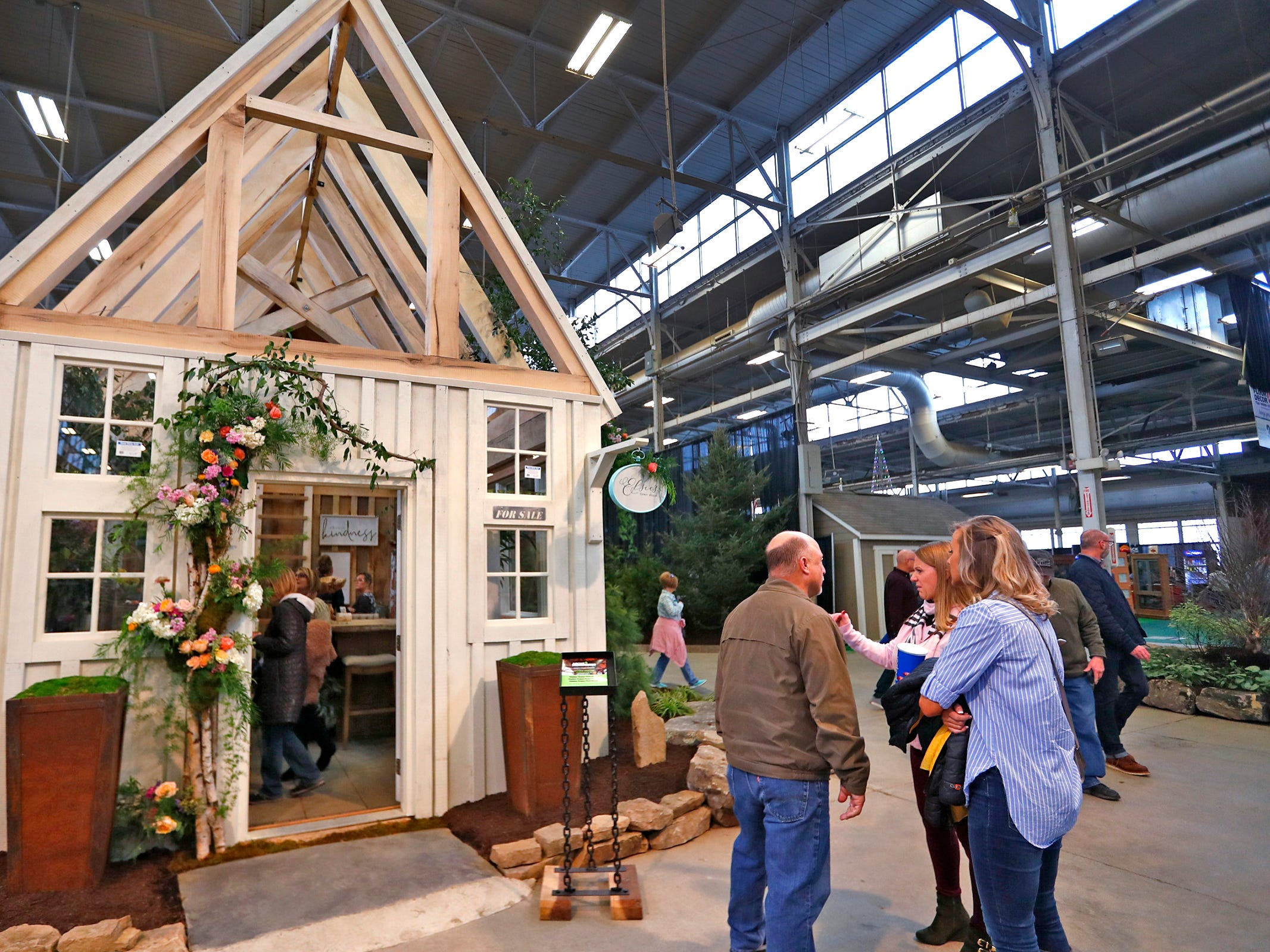 Elsie's Flower Shoppe, in this little house, includes flower for sale to take home, at the Indiana Flower + Patio Show, at the Indiana State Fairgrounds, Sunday, March 10, 2019.