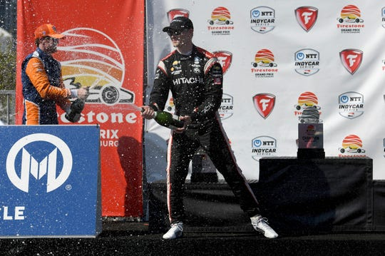Team Penske driver Josef Newgarden, of the United States, celebrates after winning the IndyCar Firestone Grand Prix of St. Petersburg (Fla.) auto race Sunday, March 10, 2019, in St Petersburg, Fla.