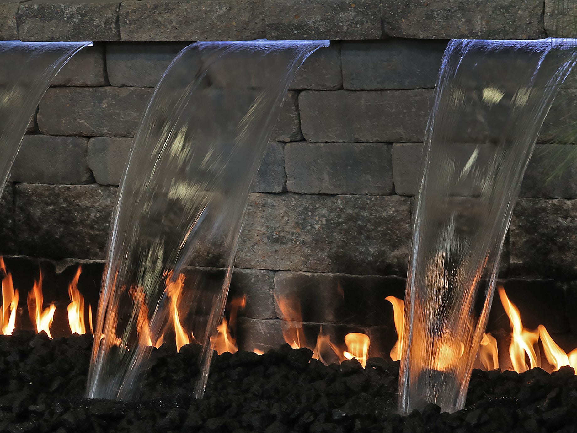 A fire pit from the Lakeshore Hardscapes display incorporates water and fire, at the Indiana Flower + Patio Show, at the Indiana State Fairgrounds, Sunday, March 10, 2019.