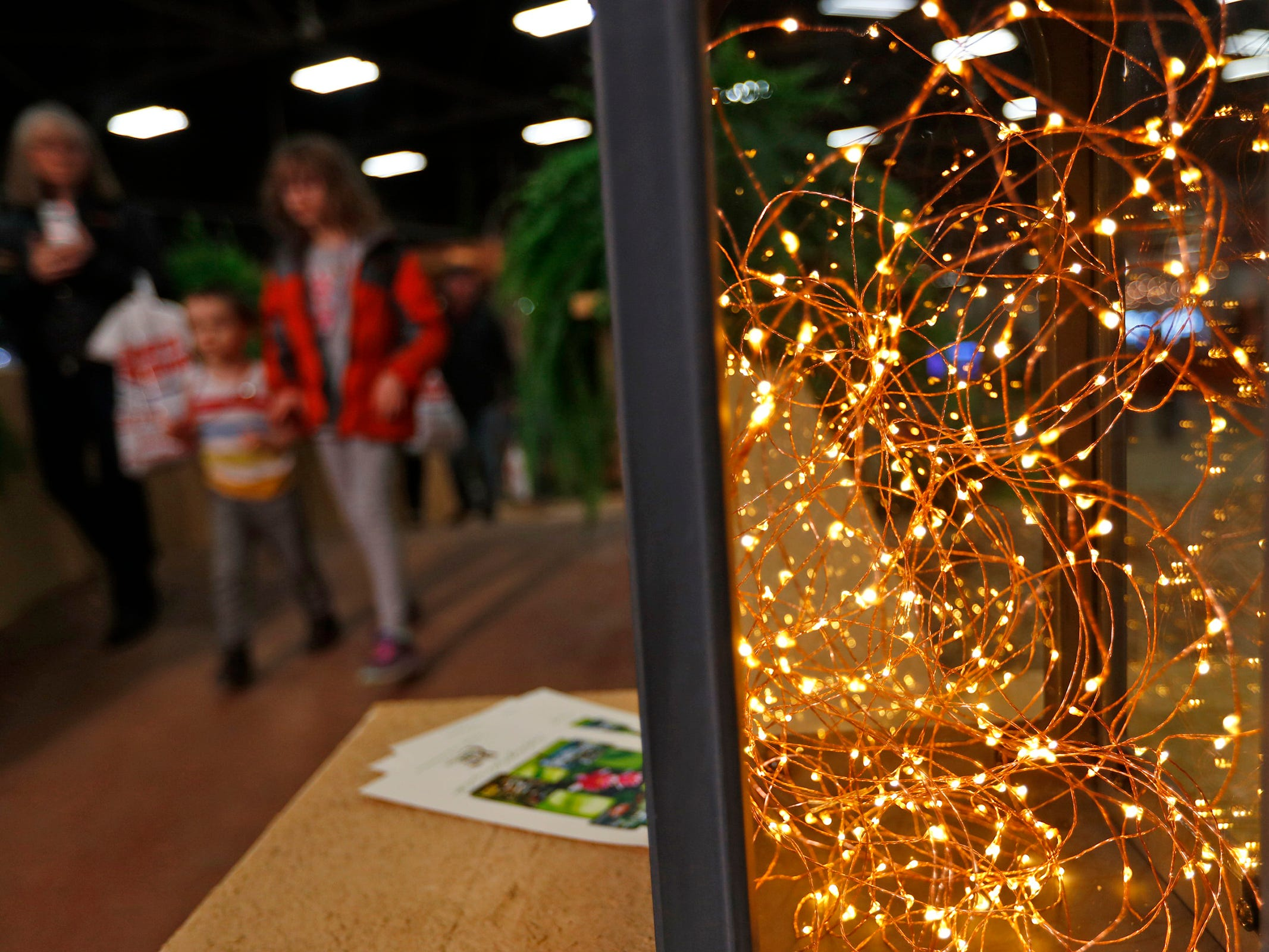 Lights appear to dance in a lantern at the Pro Care Horticultural Services display, at the Indiana Flower + Patio Show, at the Indiana State Fairgrounds, Sunday, March 10, 2019.