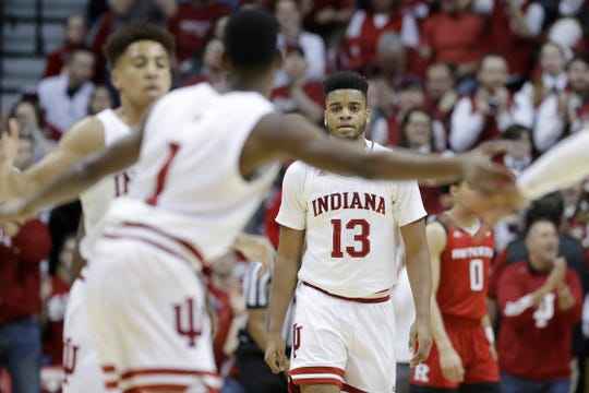 Indiana forward Juwan Morgan (13) watches as teammates celebrate during the first half of an NCAA college basketball game against Rutgers, Sunday, March 10, 2019, in Bloomington, Ind.