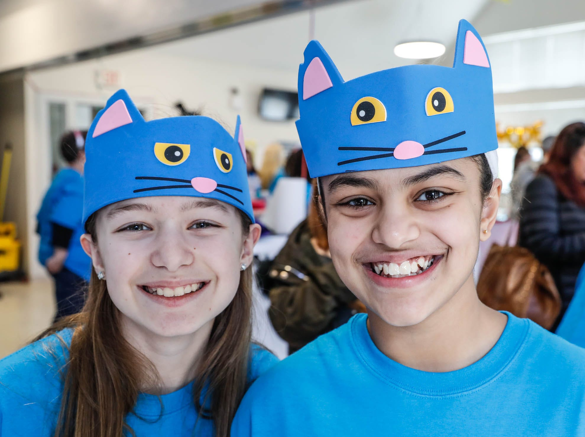 Kayla Thomas, left, and Raeva Kamath volunteer during the Puppy and Kitten Baby Shower on Sunday, March 10, 2019. The event educates families on Indy Humane's foster care program, as Fosters are needed in the spring during puppy and kitten season.