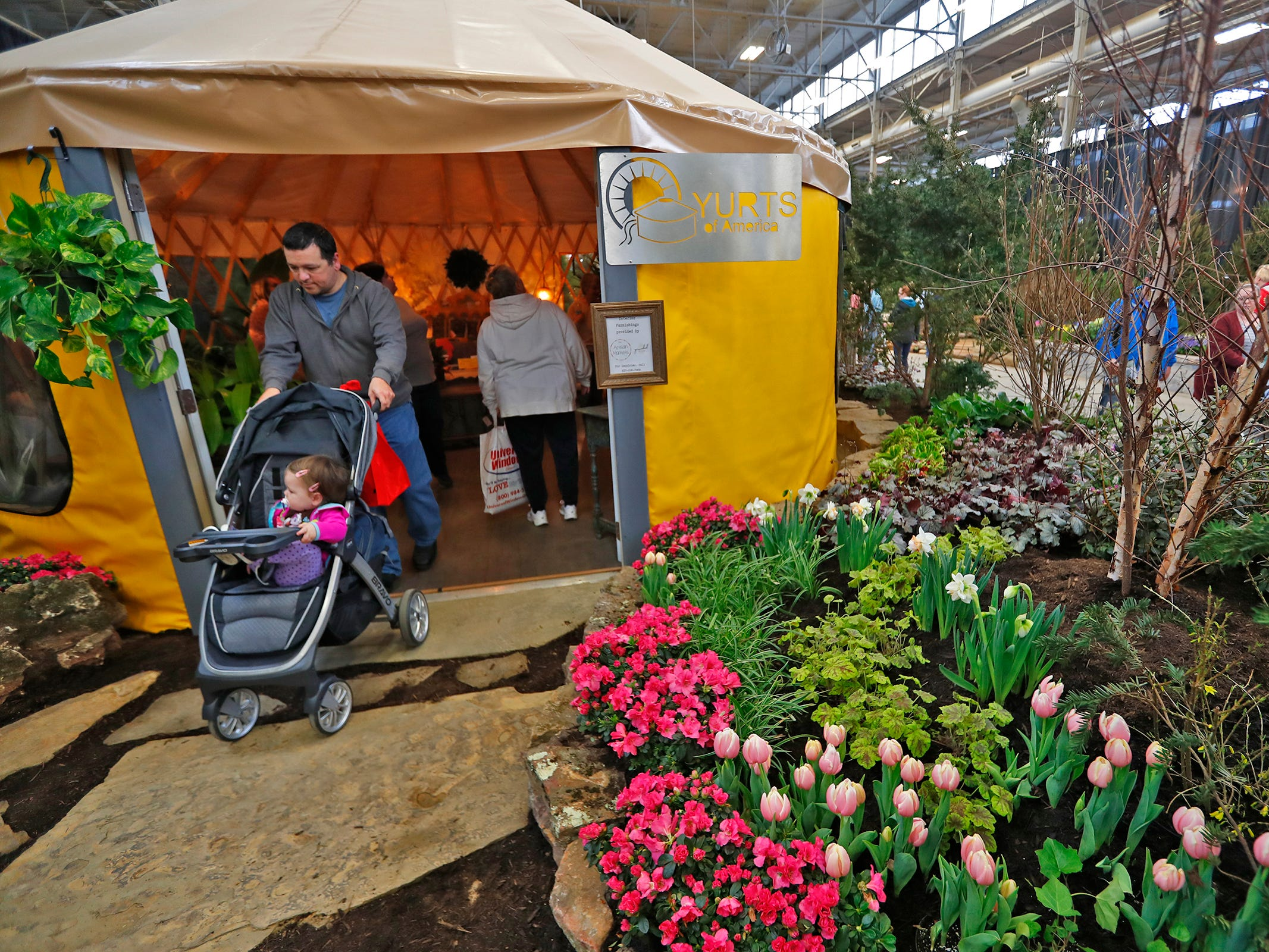People check out a Yurts of America yurt at the Indiana Flower + Patio Show, at the Indiana State Fairgrounds, Sunday, March 10, 2019.  New Leaf Landscape Design Studio worked with others to display the temporary living space.