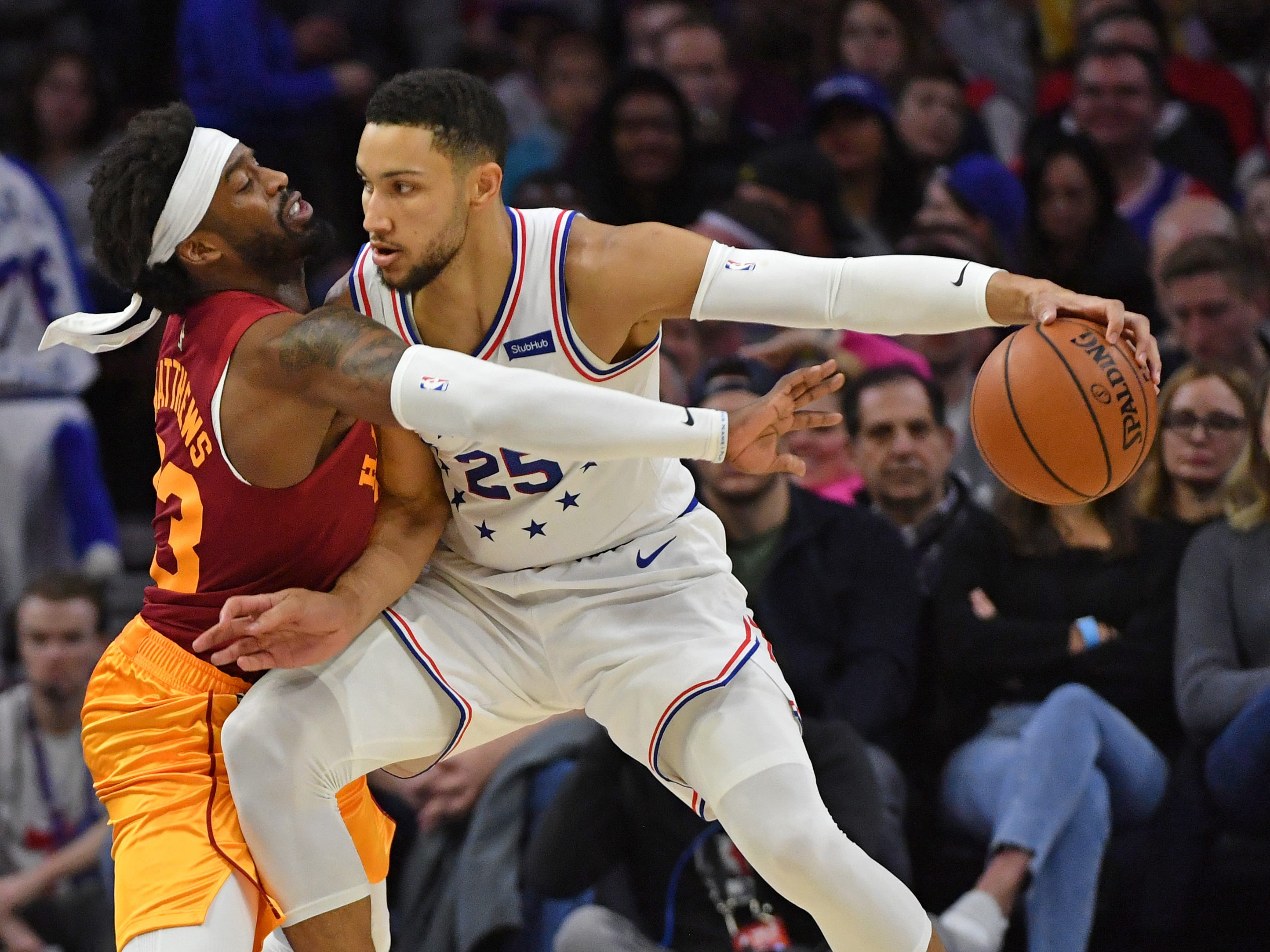 Mar 10, 2019; Philadelphia, PA, USA; Philadelphia 76ers guard Ben Simmons (25) is pressured by Indiana Pacers guard Wesley Matthews (23) during the second quarter at Wells Fargo Center.