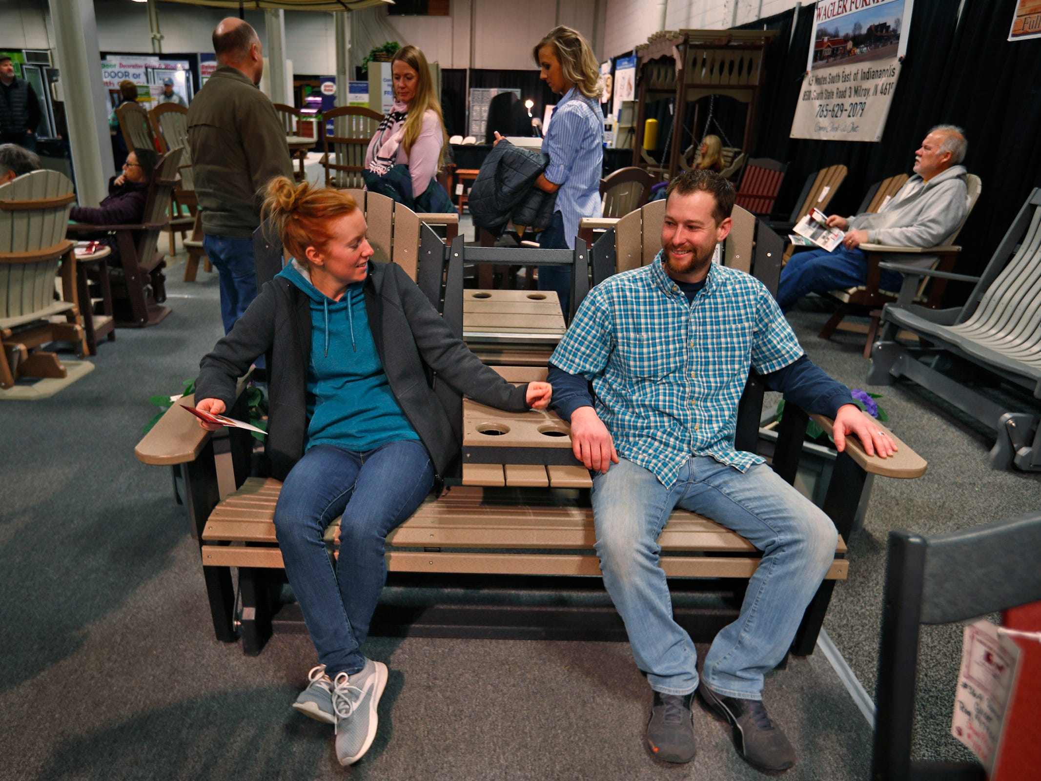 Bree and Alan Ollier try out swing chairs at the Wagler Furniture display, at the Indiana Flower + Patio Show, at the Indiana State Fairgrounds, Sunday, March 10, 2019.
