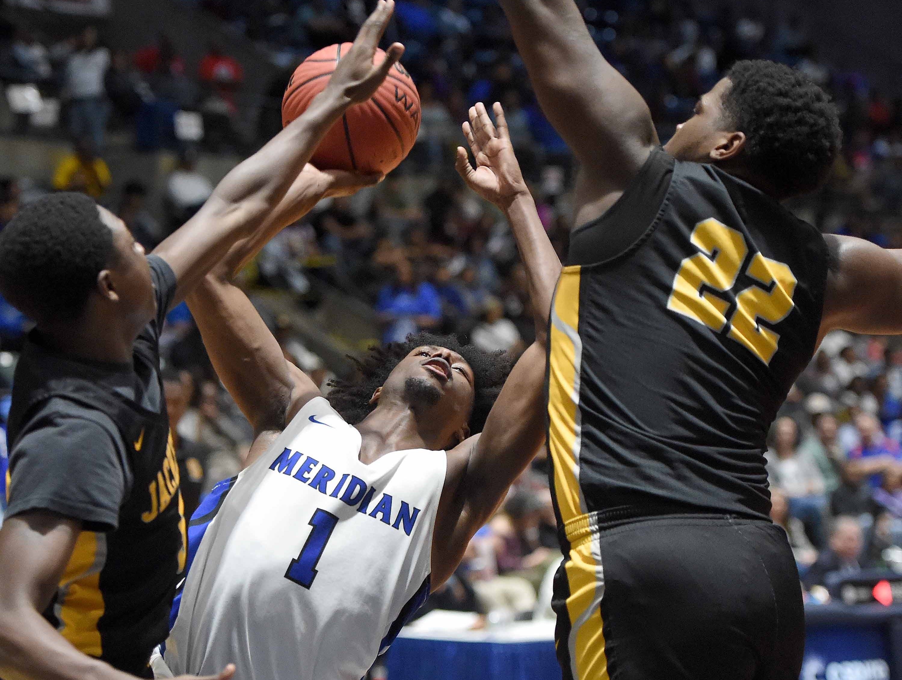 Meridian's Traemond PIttman (1) shoots against Starkville in the Class 6A finals of the MHSAA C Spire State Basketball Championships at the Mississippi Coliseum in Jackson, Miss., on Saturday, March 9, 2019.