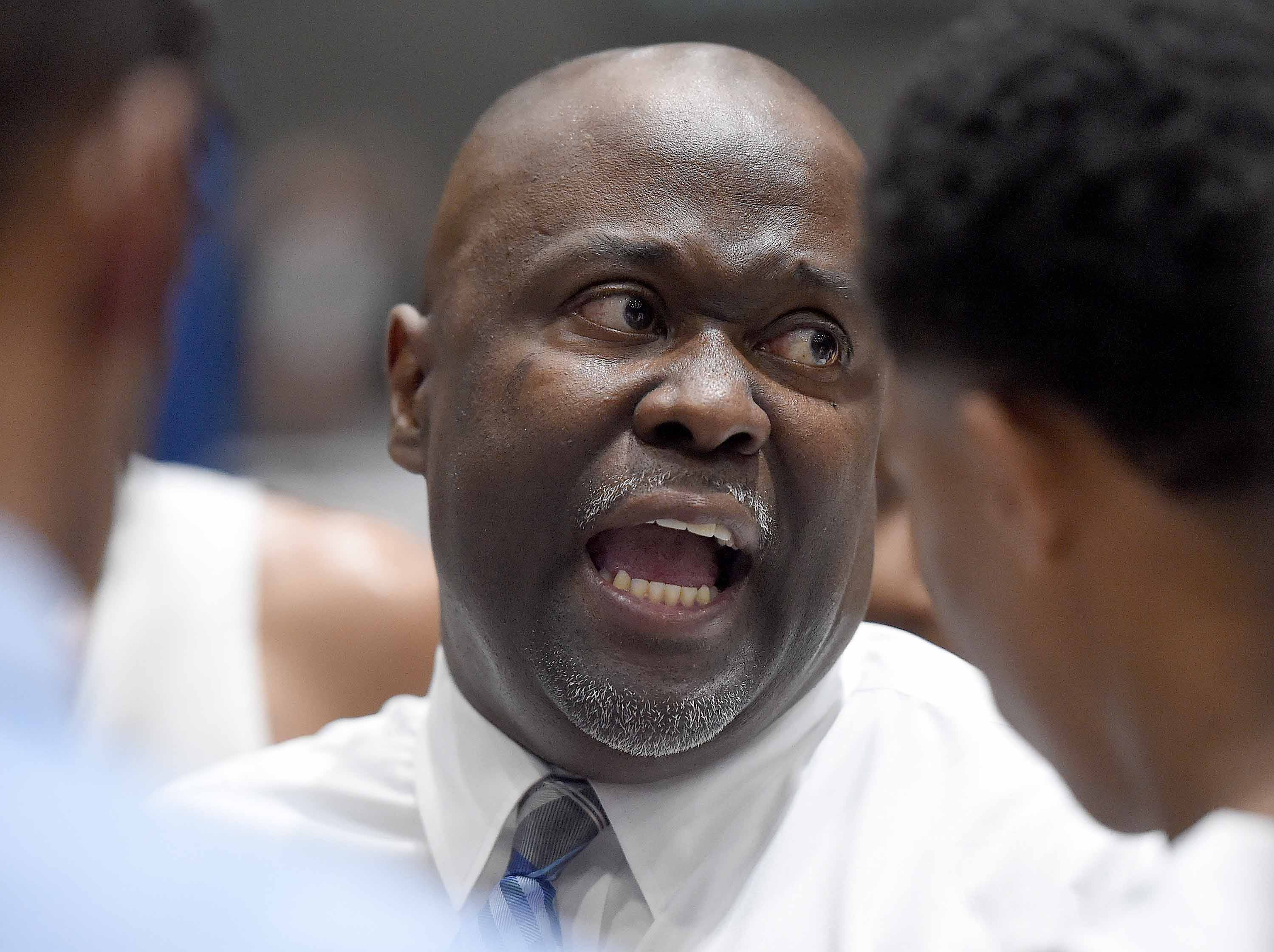 Meridian head coach Ronald Norman talks to the Wildcats in the finals of the Class 6A finals of the MHSAA C Spire State Basketball Championships at the Mississippi Coliseum in Jackson, Miss., on Saturday, March 9, 2019.