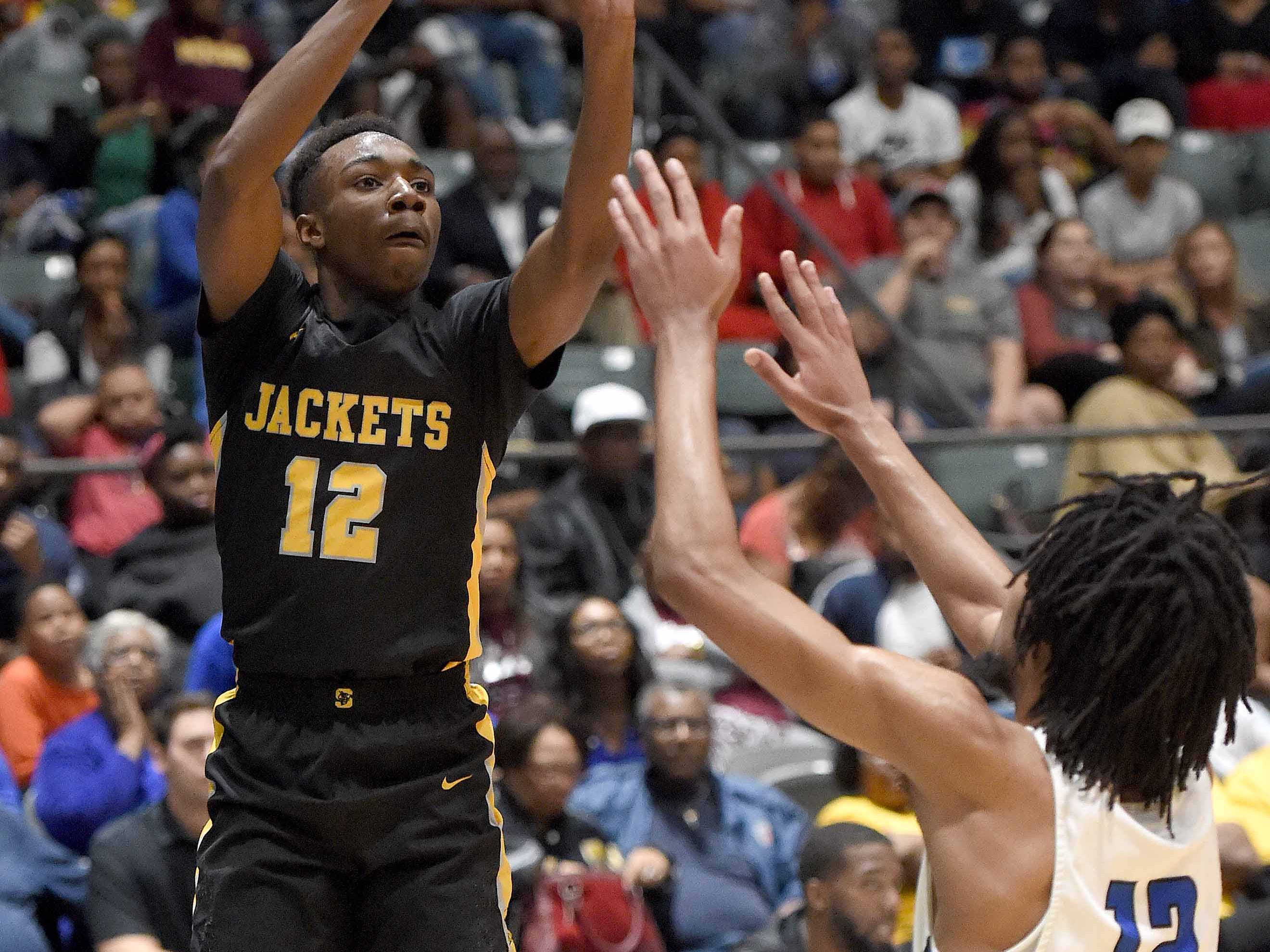 Starkville's Coltie Young (left) shoots over Meridian's Vontrell Pringle in the Class 6A finals of the MHSAA C Spire State Basketball Championships at the Mississippi Coliseum in Jackson, Miss., on Saturday, March 9, 2019.