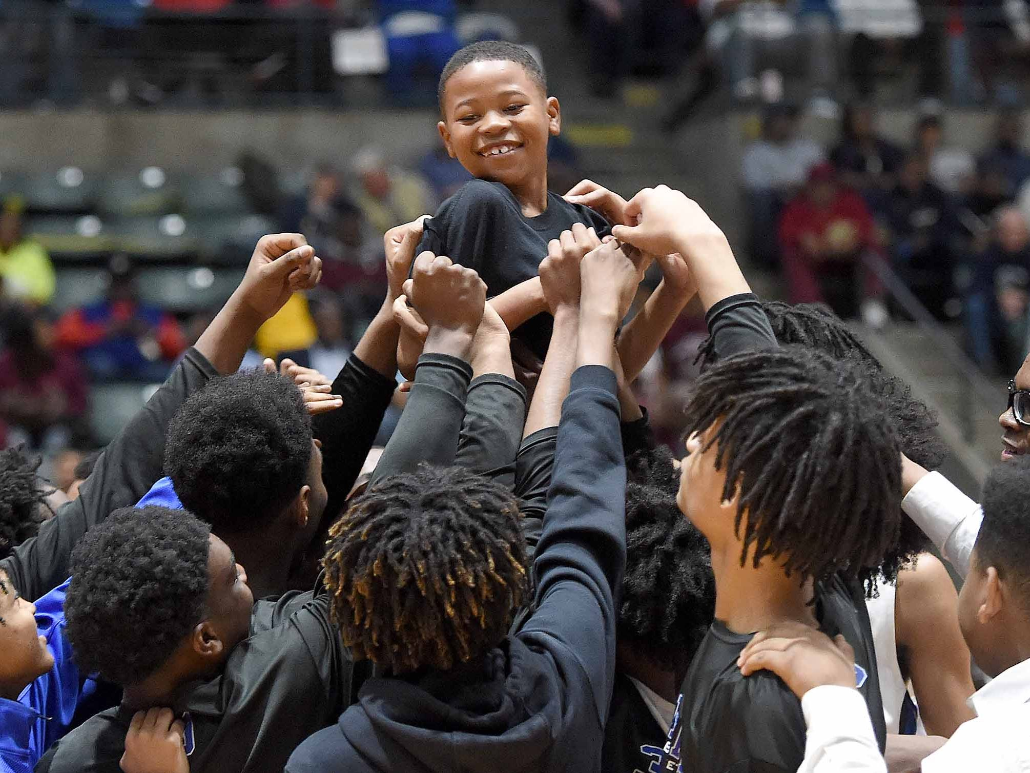 The Meridian Wildcats huddle before the game in the Class 6A finals of the MHSAA C Spire State Basketball Championships at the Mississippi Coliseum in Jackson, Miss., on Saturday, March 9, 2019.