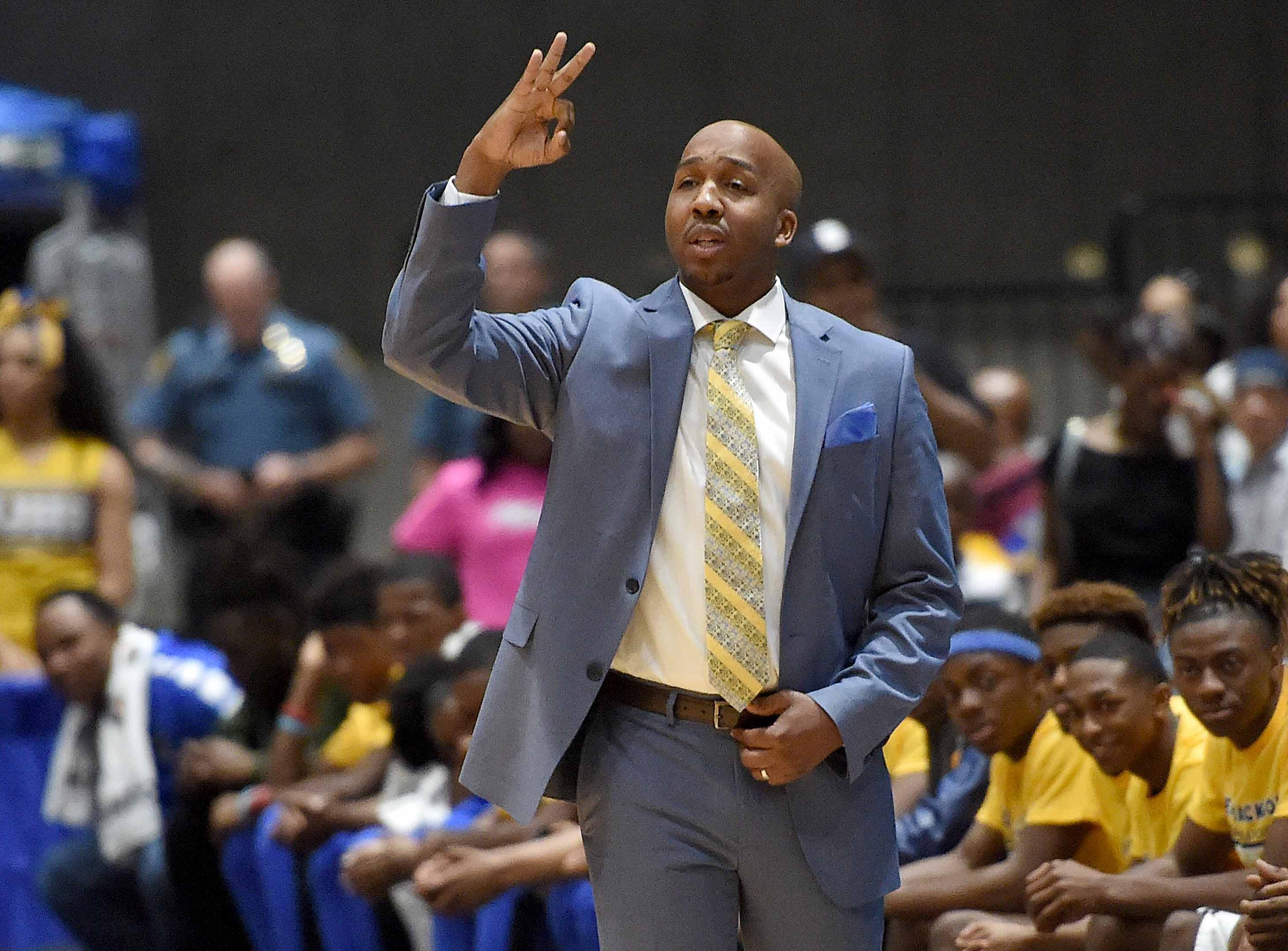 Velma Jackson head coach Chris Love signals a play in the finals of the MHSAA C Spire State Basketball Championships at the Mississippi Coliseum in Jackson, Miss., on Saturday, March 9, 2019.