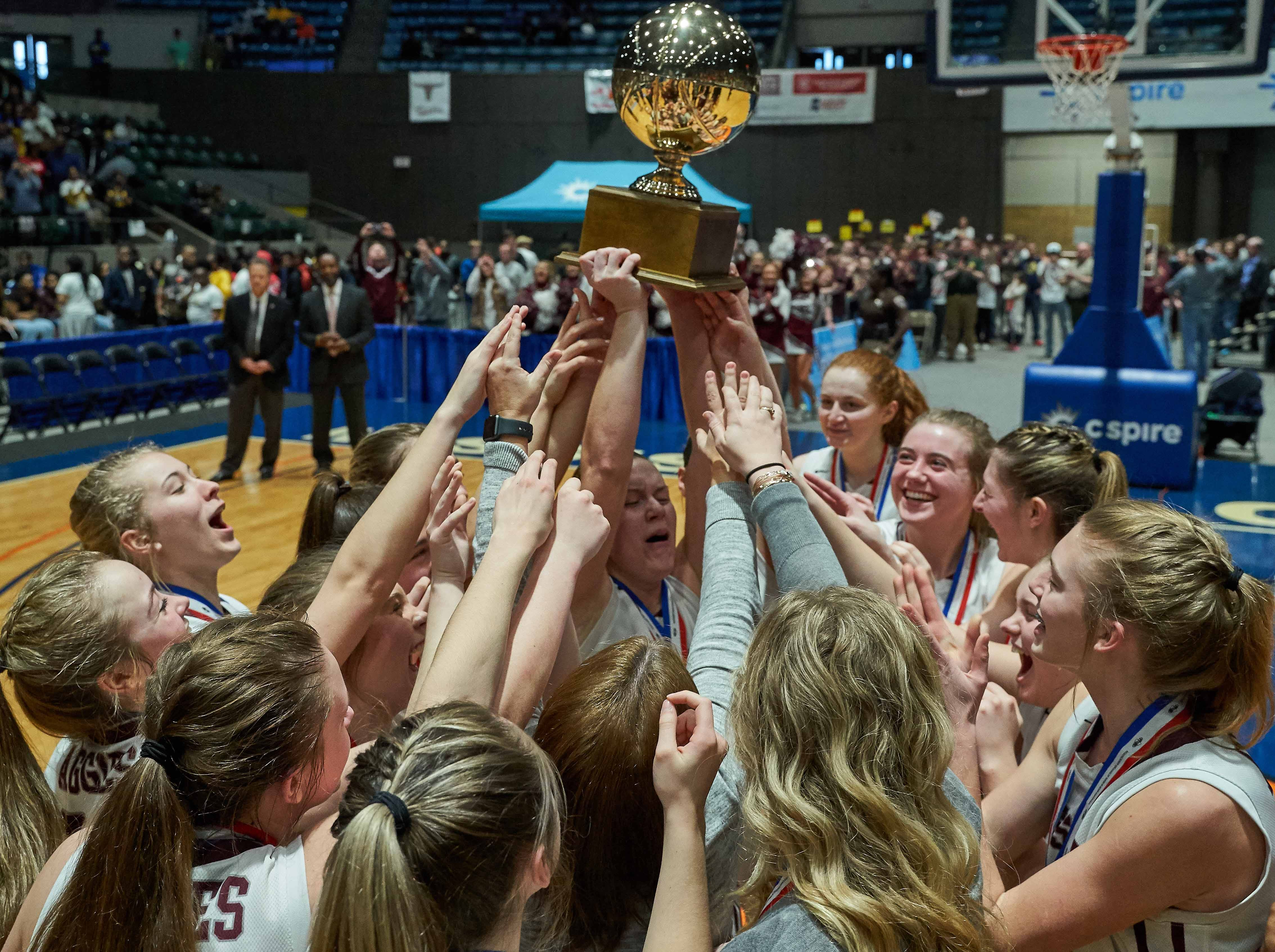 Kossuth celbrates with the trophy following their 48-44 win against Belmont in the MHSAA 3A Girls Basketball Championship Finals held at the Mississippi Coliseum in Jackson, MS, Saturday March 9th, 2019.(Bob Smith)