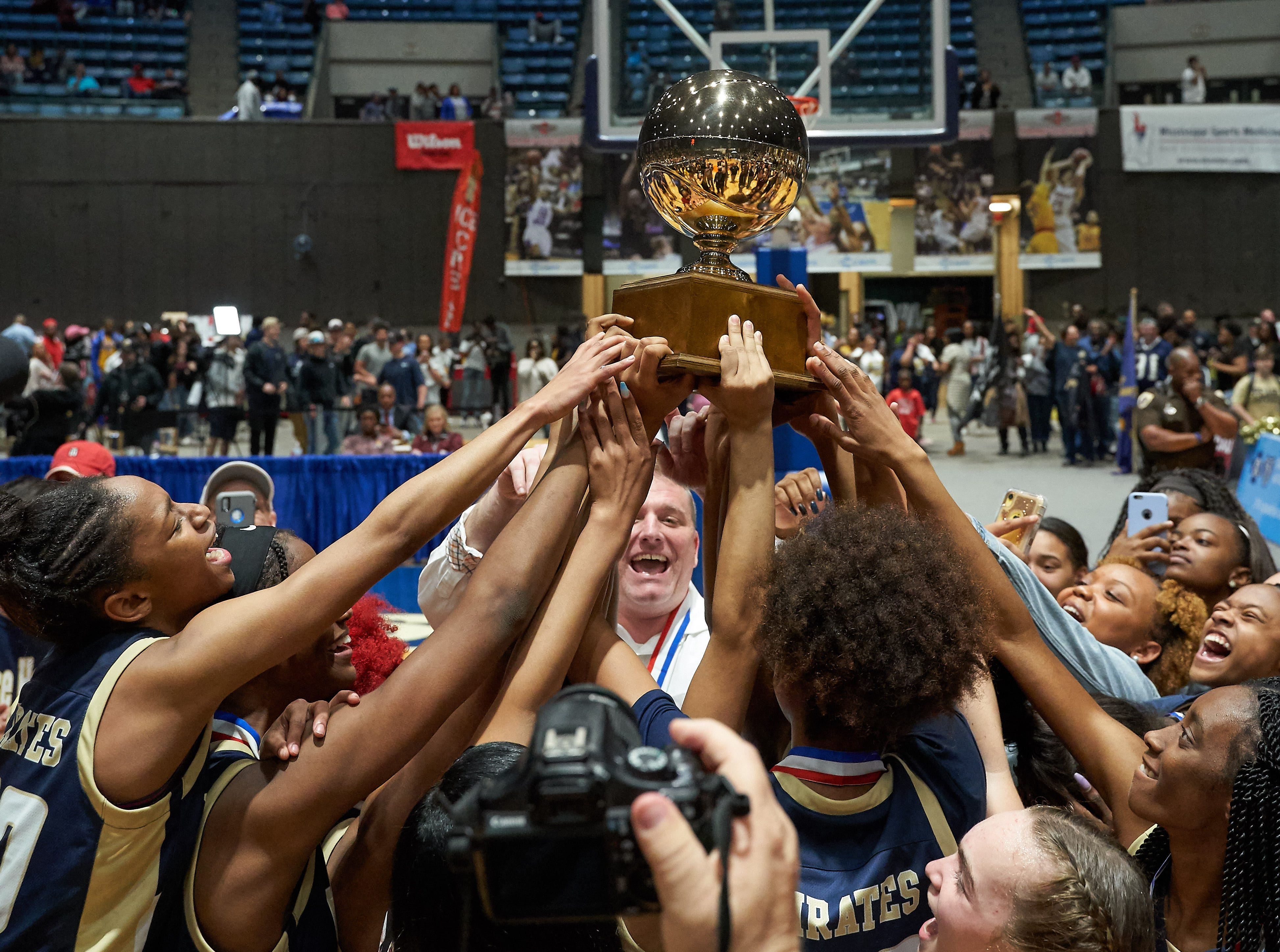 Pearl players and coaches hoist the trophy following the Lady Pirates 59-48 win over Terry in the MHSAA 6A Girls Basketball Championship Finals held at the Mississippi Coliseum in Jackson, MS, Saturday March 9th, 2019.(Bob Smith)