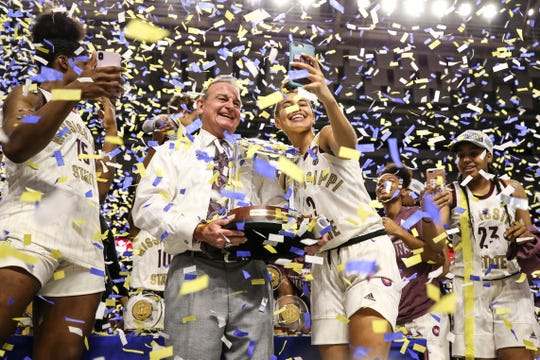 Mississippi State head coach Vic Schaefer celebrates the program's first SEC Tournament title with sophomore guard Andra Espinoza-Hunter in Greenville, S.C.